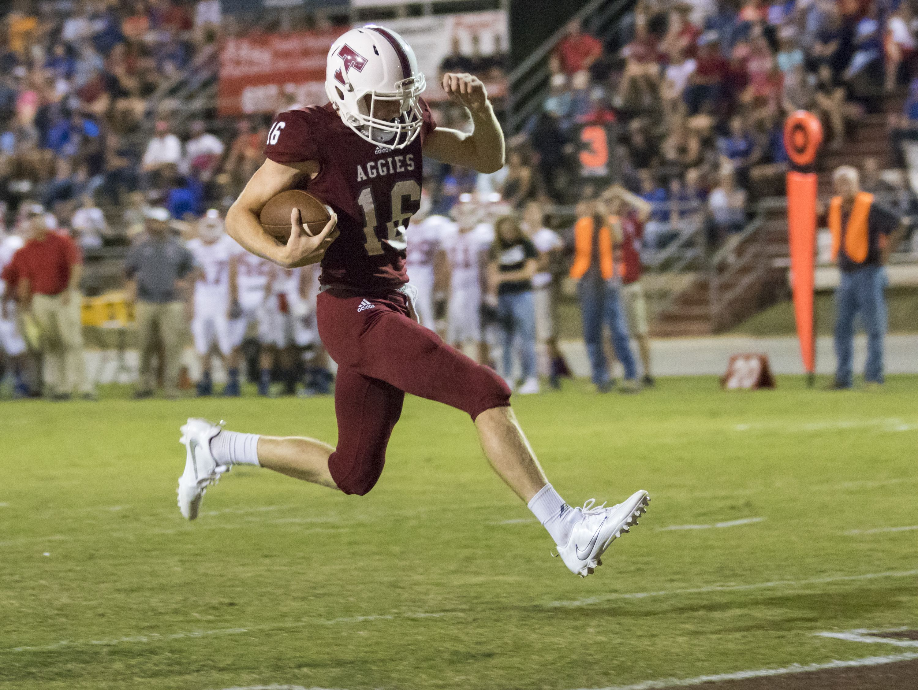 Quarterback Jack Henry (16) high steps into the endzone to go up 21 - 0 during the Pace vs Tate football game at Tate High School on Friday, October 7, 2016.