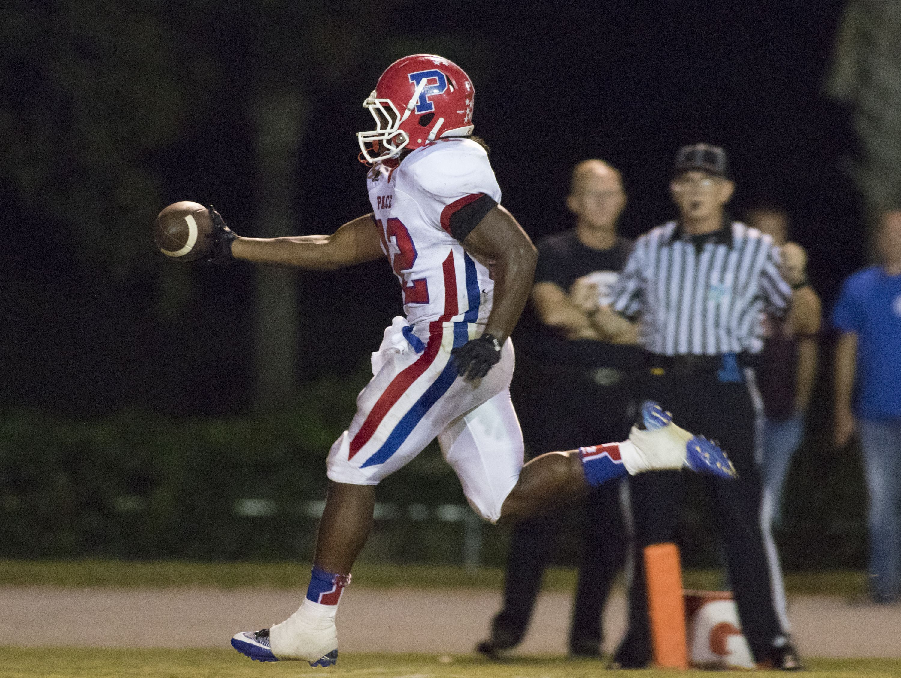 Anthony Johnson Jr. (32) walks into the endzone during the Pace vs Tate football game at Tate High School on Friday, October 7, 2016.