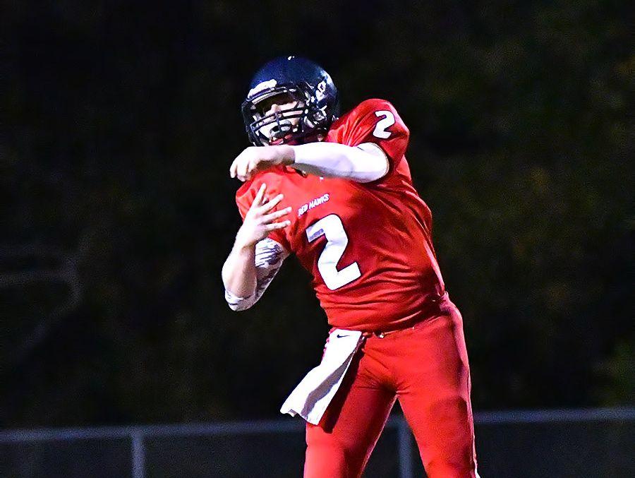 Creek Wood's Devon Higgins fires a pass to a teammate.