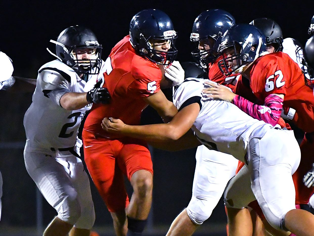 Daniel Davila fights through a couple of tackles for tough yardage
