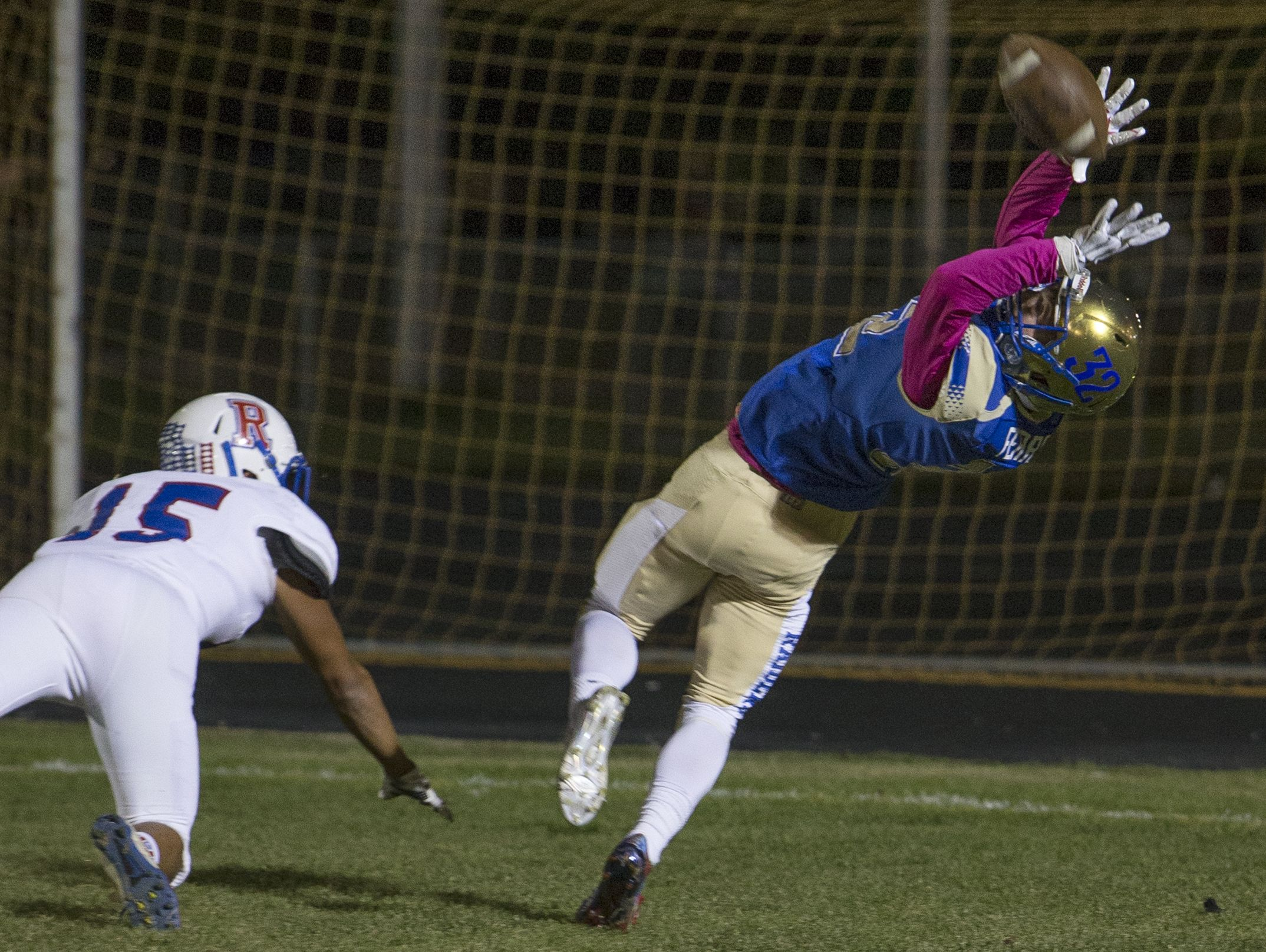 Reed's Robert Ferrel can't make the catch in the end zone against Reno, but pass interference was called on the play, during the football game played on Friday night, October 7, 2016 at Reed High School in Sparks, Nevada.