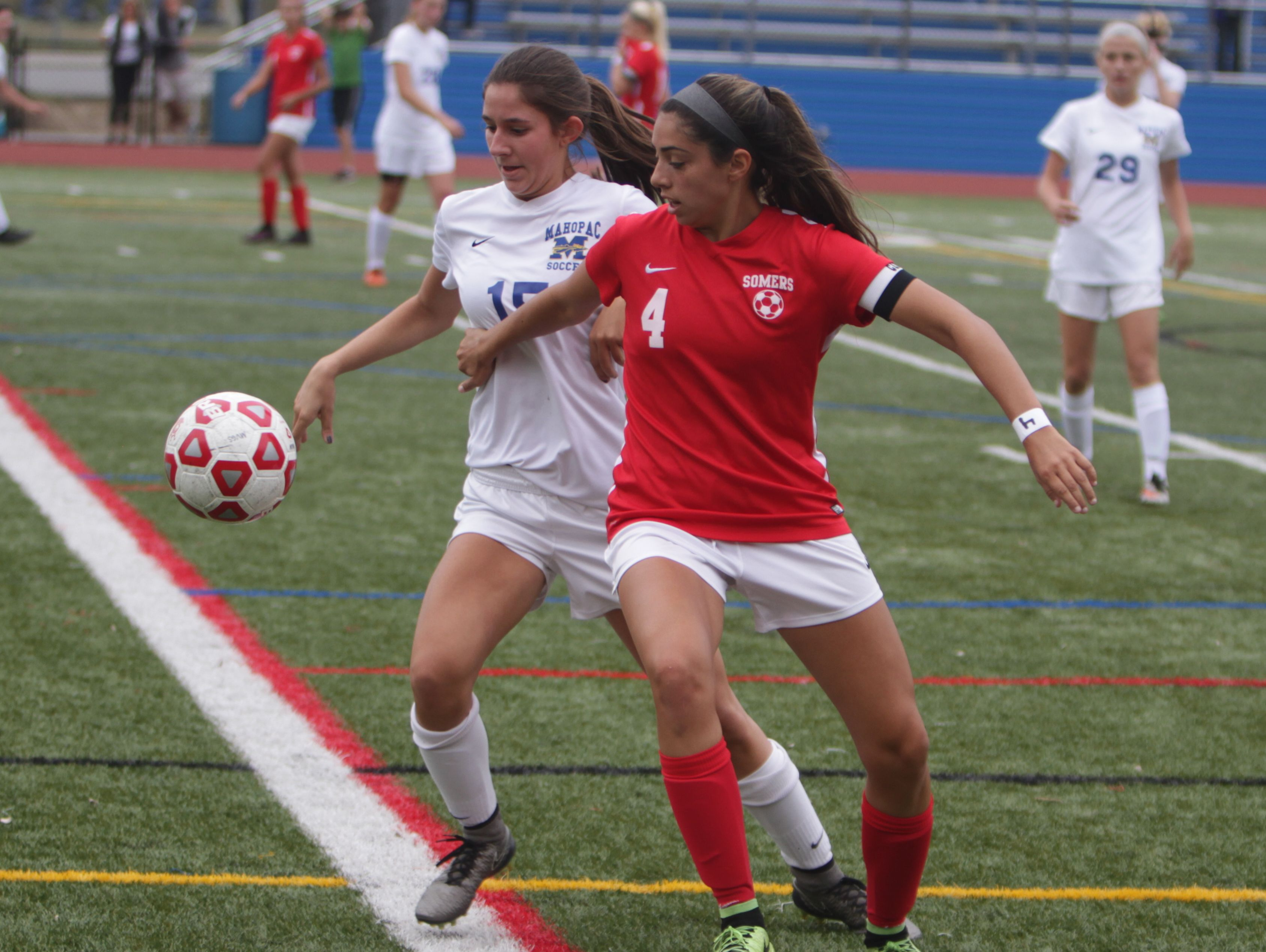 Mahopac's Zina McInerney (left) and Somers' Ciara Ostrander battle for possession of the ball during a Section 1 girls soccer game between Mahopac and Somers at Mahopac High School on Saturday, Oct. 8th, 2016. Somers won 2-0.