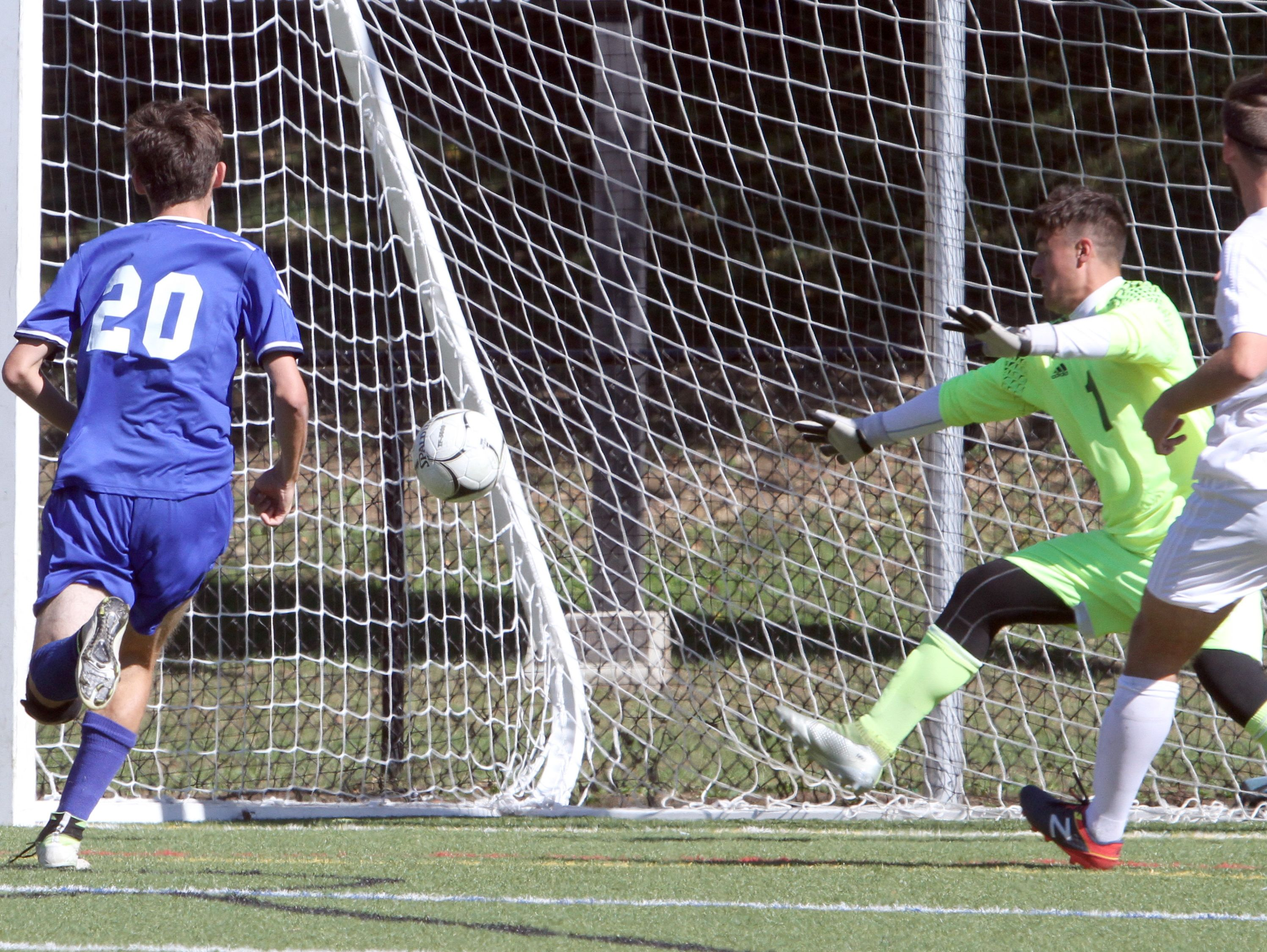Goshen's Liam Kelly scores the winning goal on Valhalla goalkeeper Lorenzo Luciano in overtime during the Section 1 vs. Section 9 boys soccer challenge at Mamaroneck High School Oct. 10, 2016. Goshen defeated Valhalla 1-0.