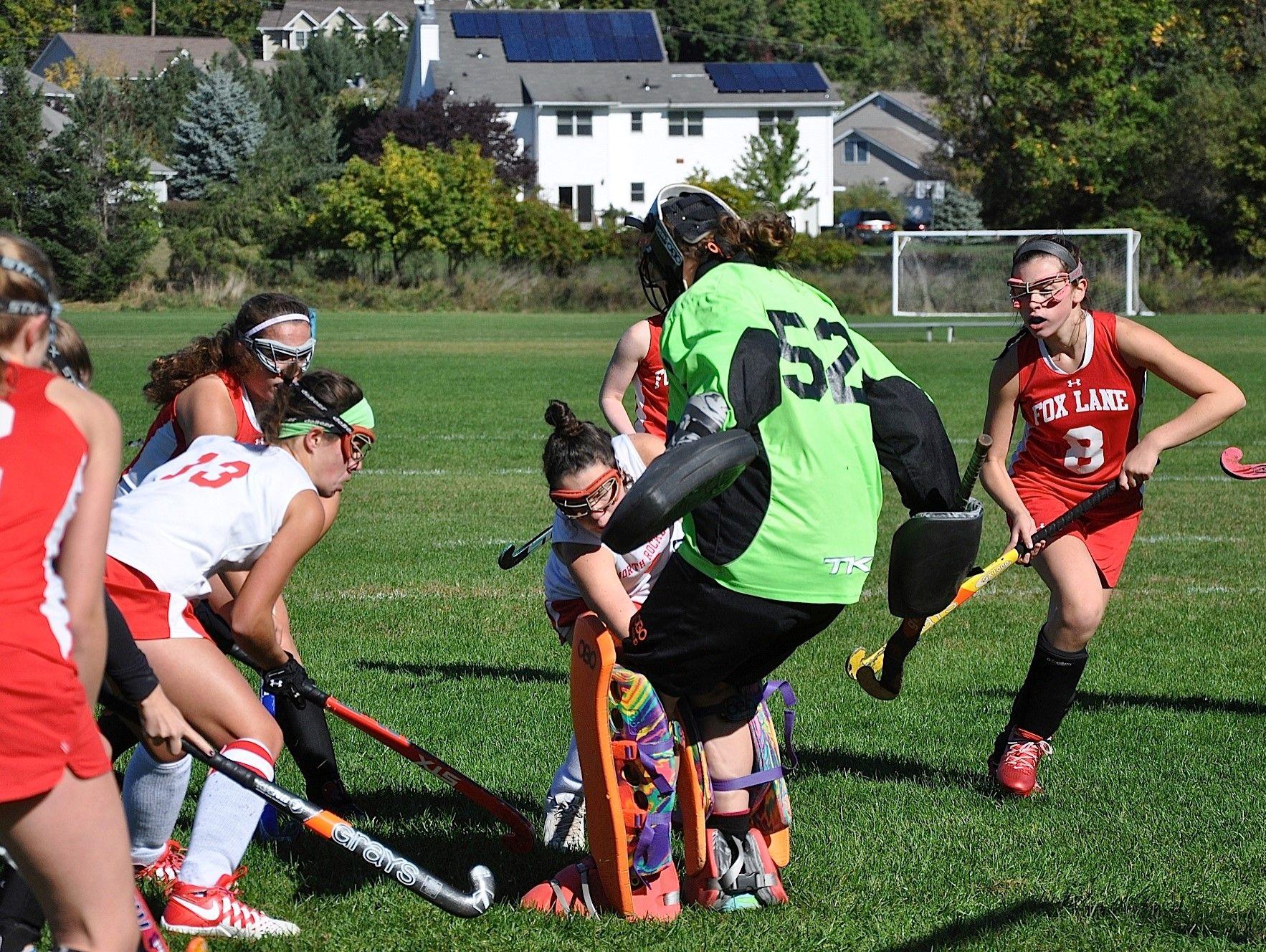 Fox Lane goalie Grace Kiernan stops Caitlin Lynch as Kerri Gutenberger (13) looks for rebound.