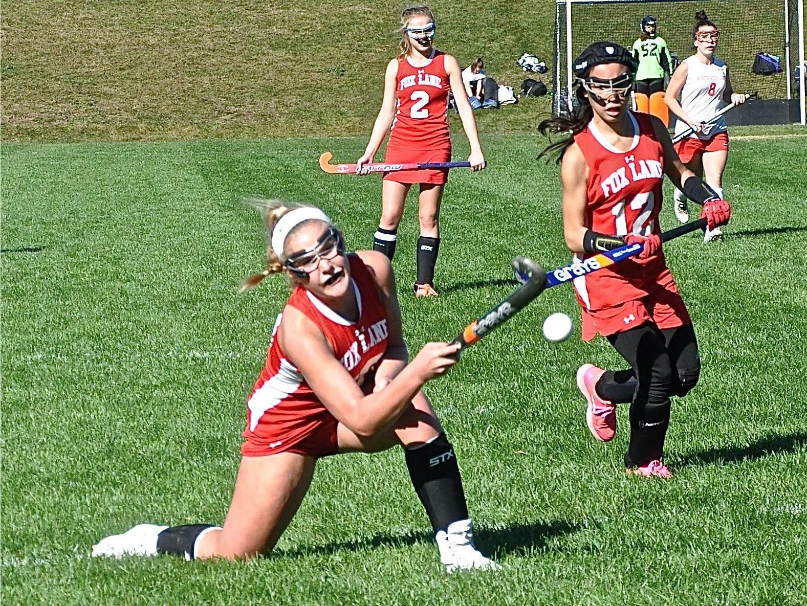 Fox Lane's Olivia Dey flips ball off corner. The flip was ruled dangerous and the play halted..
