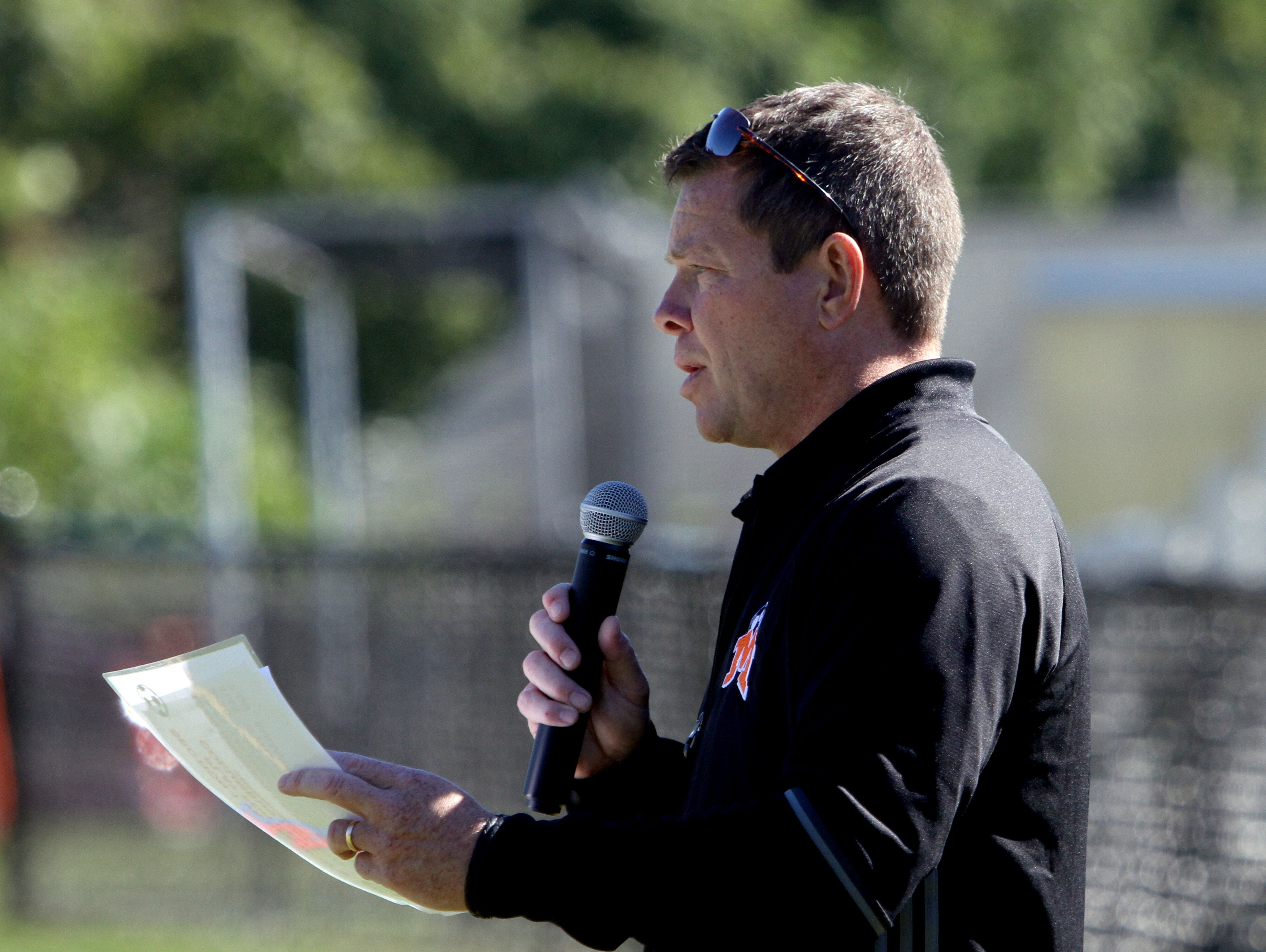 Mamaroneck High School soccer coach Rich Becker announces the teams during a game in the Section 1 vs. Section 9 boys soccer challenge at Mamaroneck High School Oct. 10, 2016.