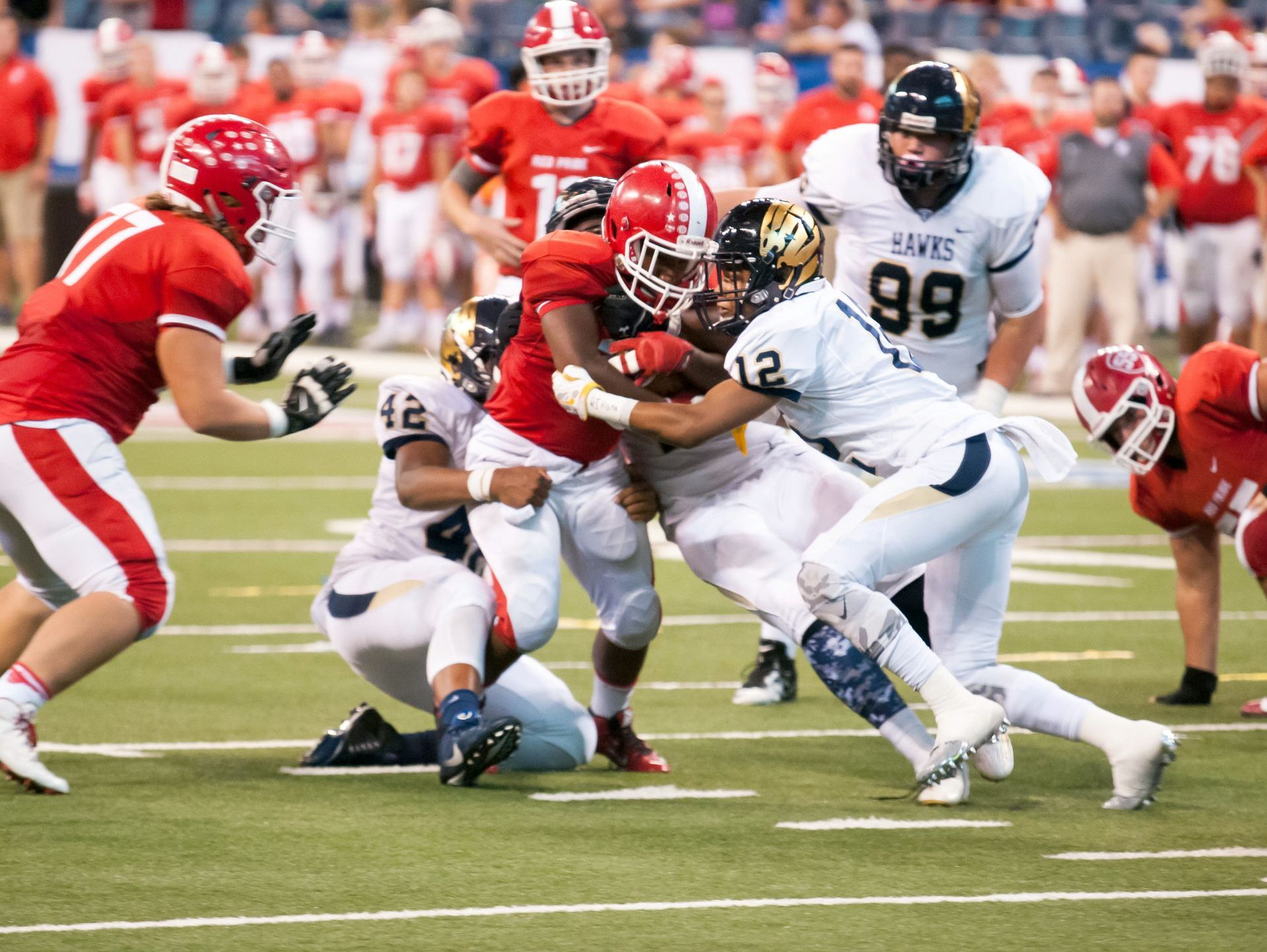 Decatur Central sophomore safety Larry Tracy III (12) making tackle vs. Plainfield at Lucas Oil Stadium.