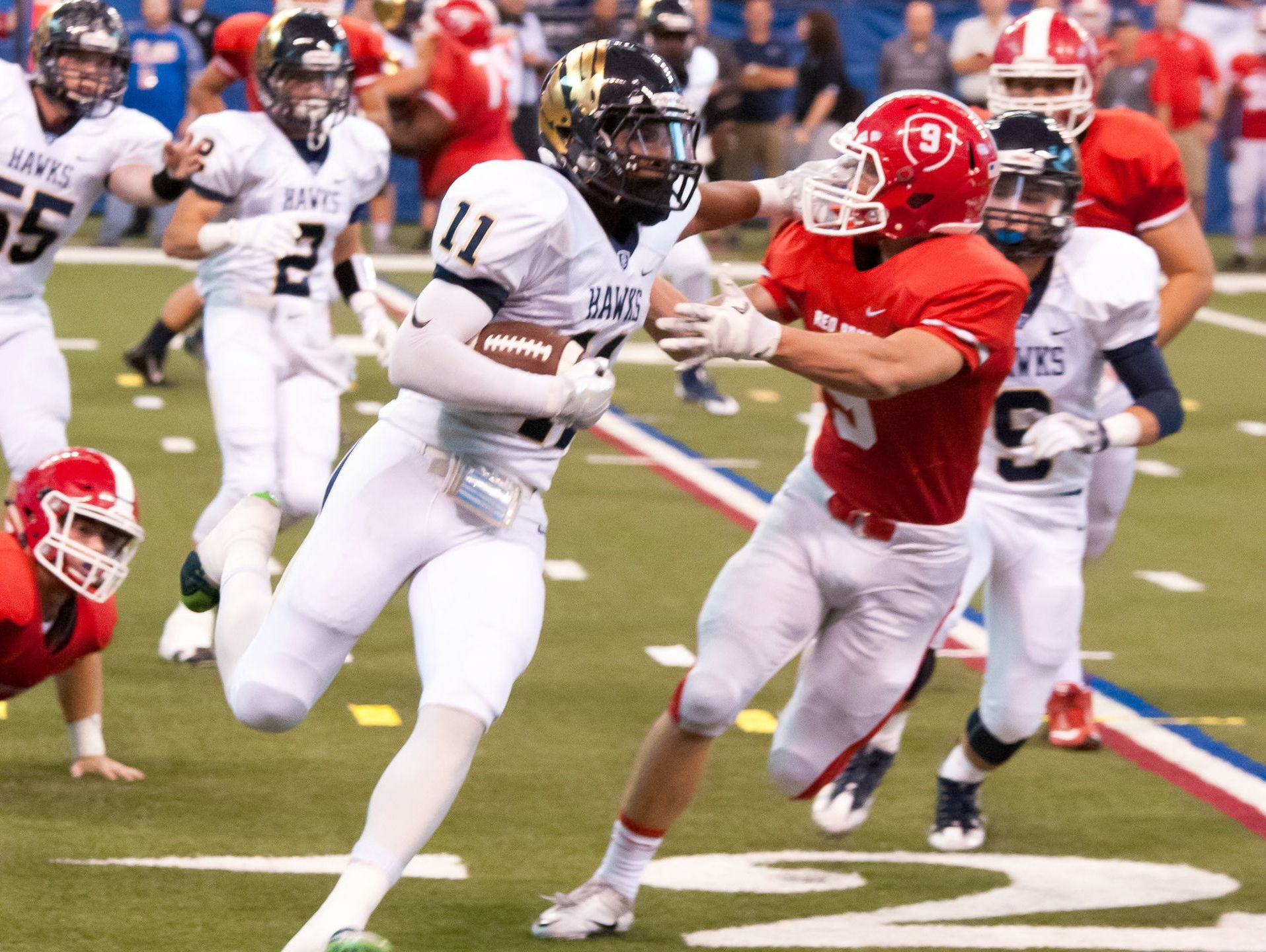 Decatur Central junior slot-back (11) Tyrone Tracy Jr. on offense against Plainfield at Lucas Oil Stadium on Sept. 24, 2016.