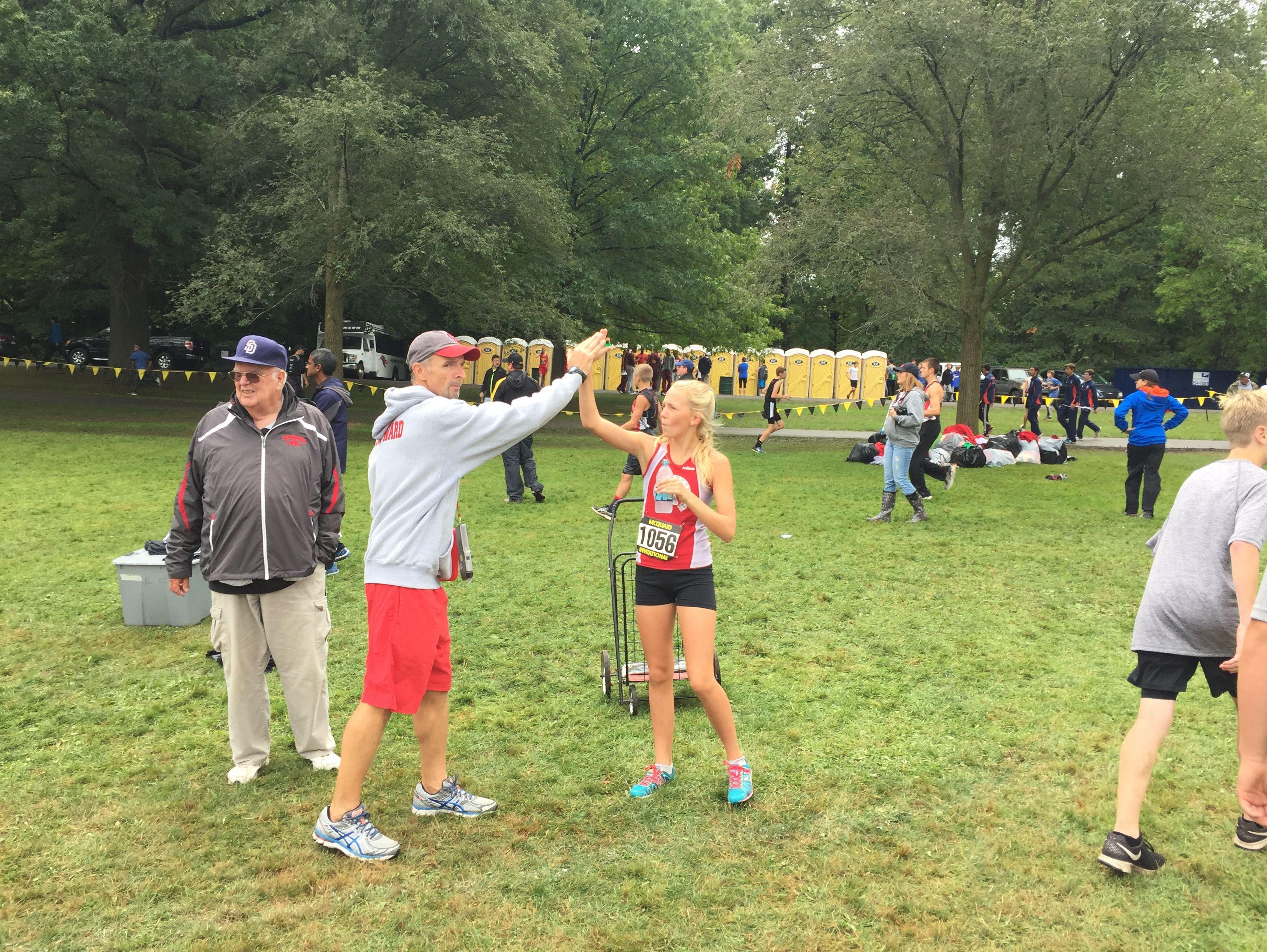 Canandaigua coach Matt Ward firing up runners before a seeded race at the 2016 McQuaid Invitational