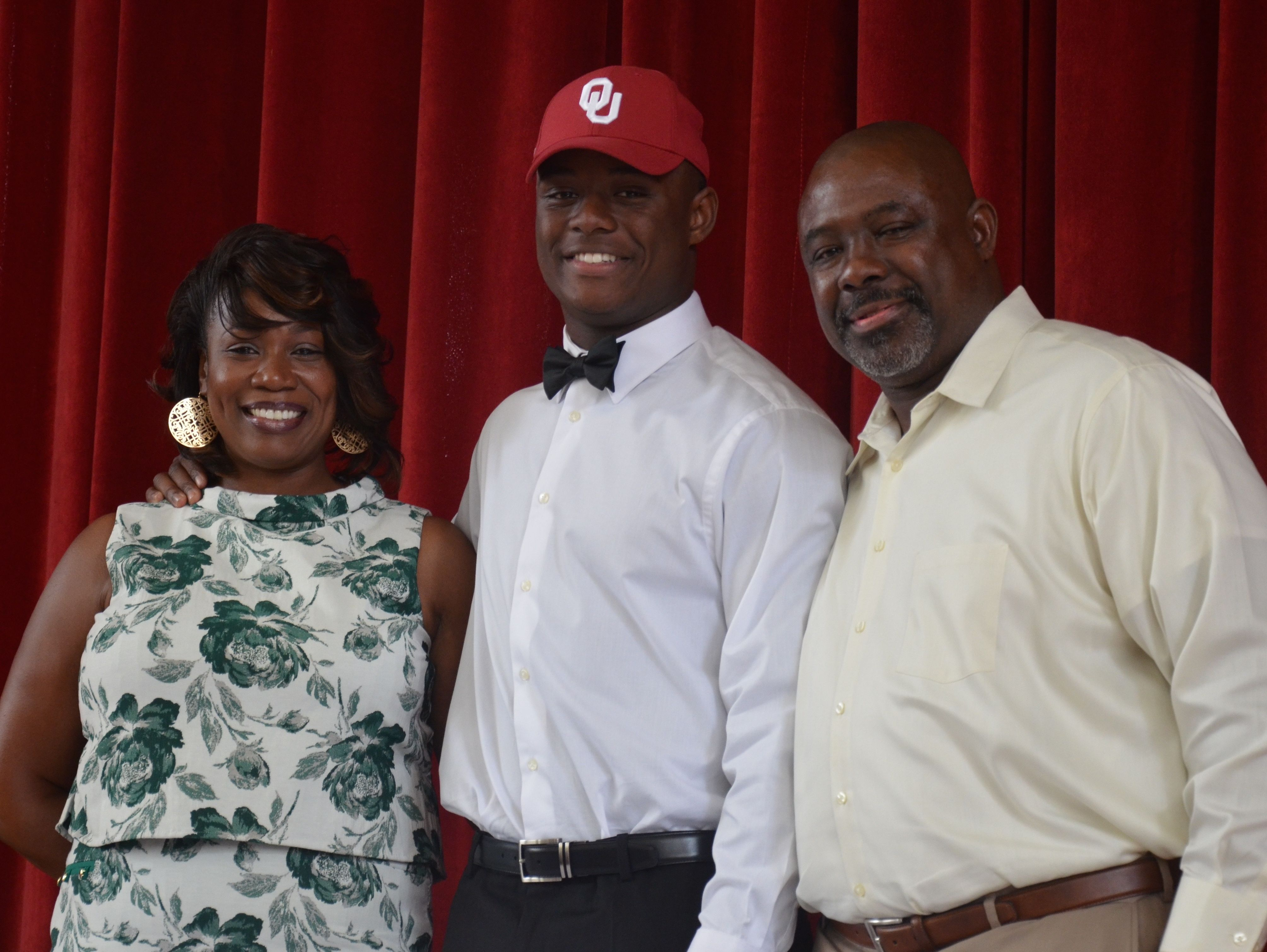East Nashville linebacker Jacob Phillips, joined by his mother Tami and father Derrick, committed to Oklahoma on Wednesday afternoon.