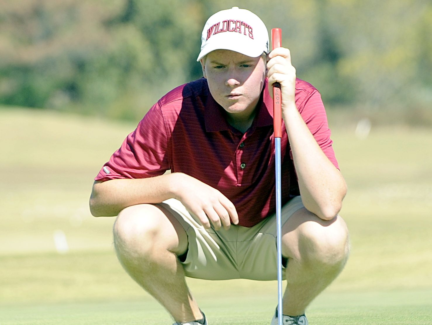 Tullahoma sophomore Jacob Uehlein reads the slope of the ninth green before putting. Uehlein helped Tullahoma finish in third place.