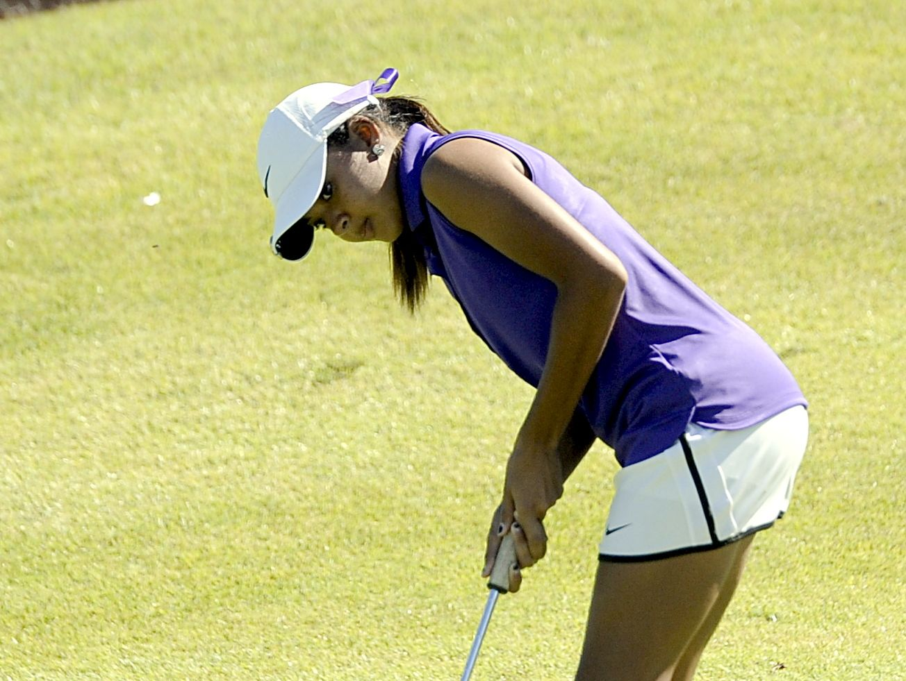Clarksville senior Mariah Smith watches her putt on the 18th green. Smith shot 68 on Wednesday.