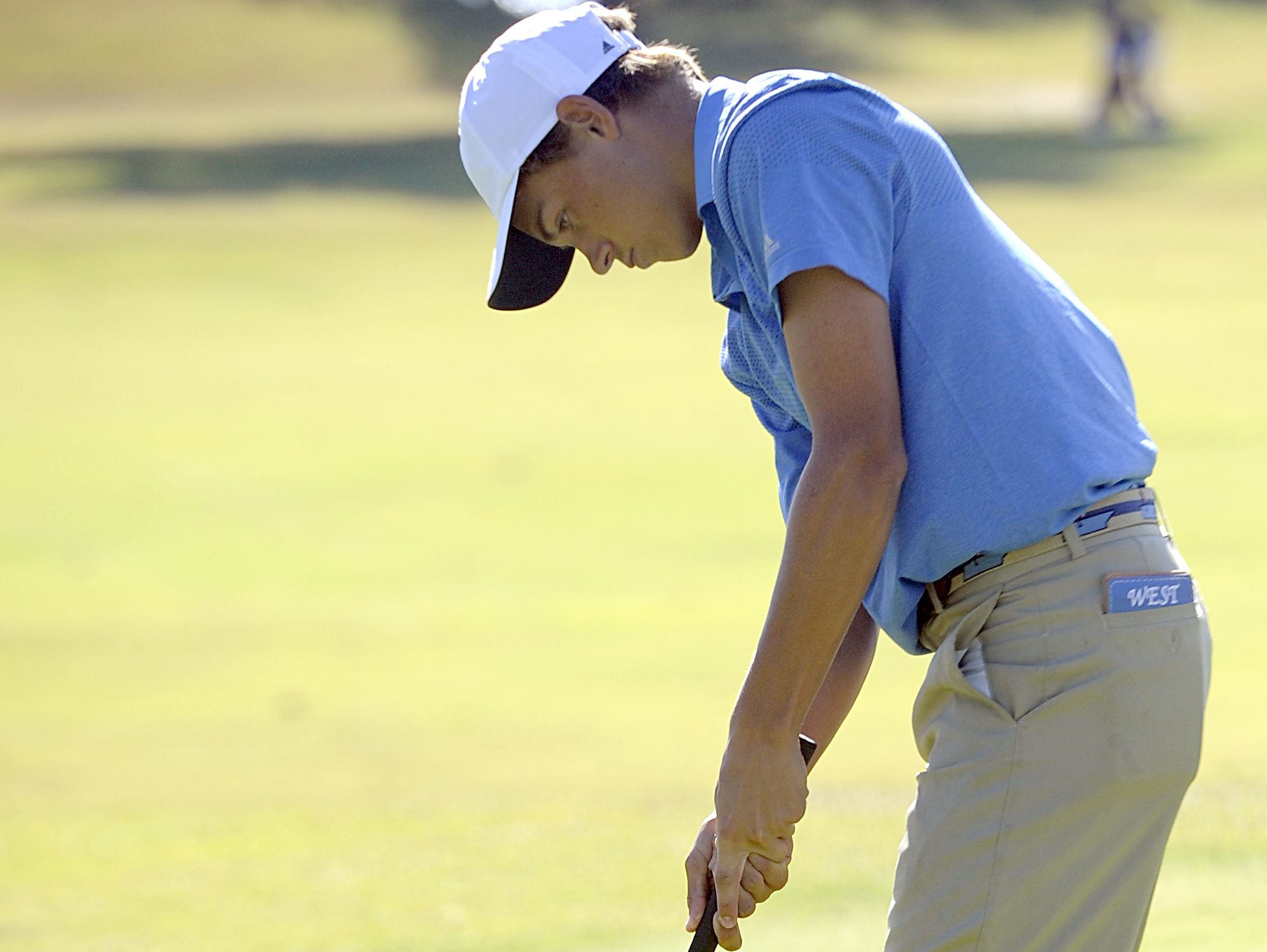 Brentwood sophomore Trenton Johnson taps in for a birdie on the final hole of his Wednesday round of 71.
