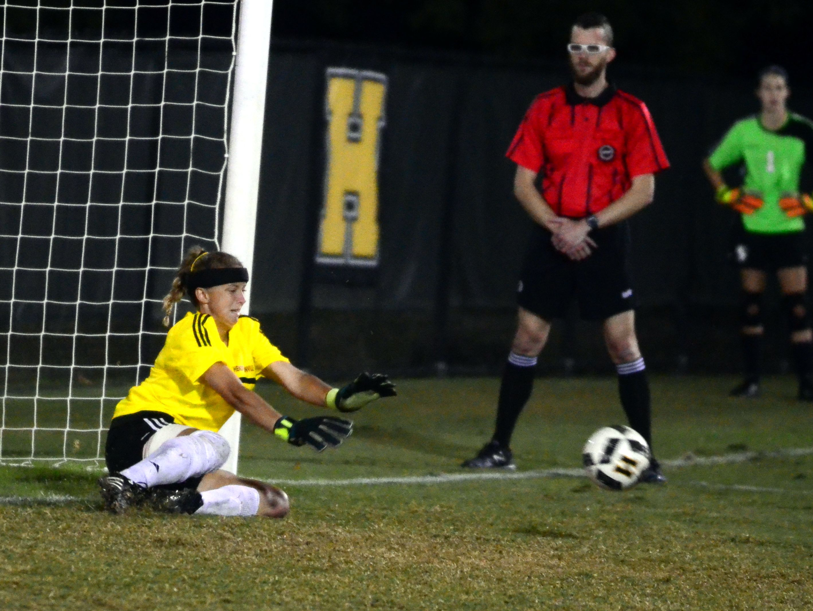 Hendersonville senior goalkeeper Makensie Cotter makes a save during the penalty-kick shootout against Station Camp.
