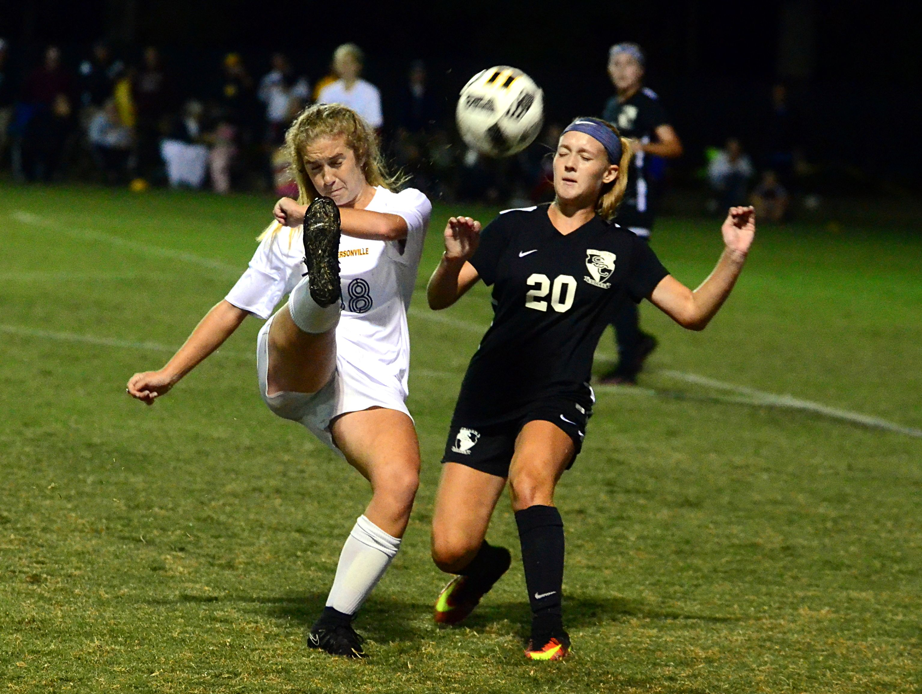 Hendersonville High junior Haley Stevens flicks the ball behind her over Station Camp sophomore Katie Koumiss during first-half action. Stevens scored the game-winning penalty kick in the shootout.