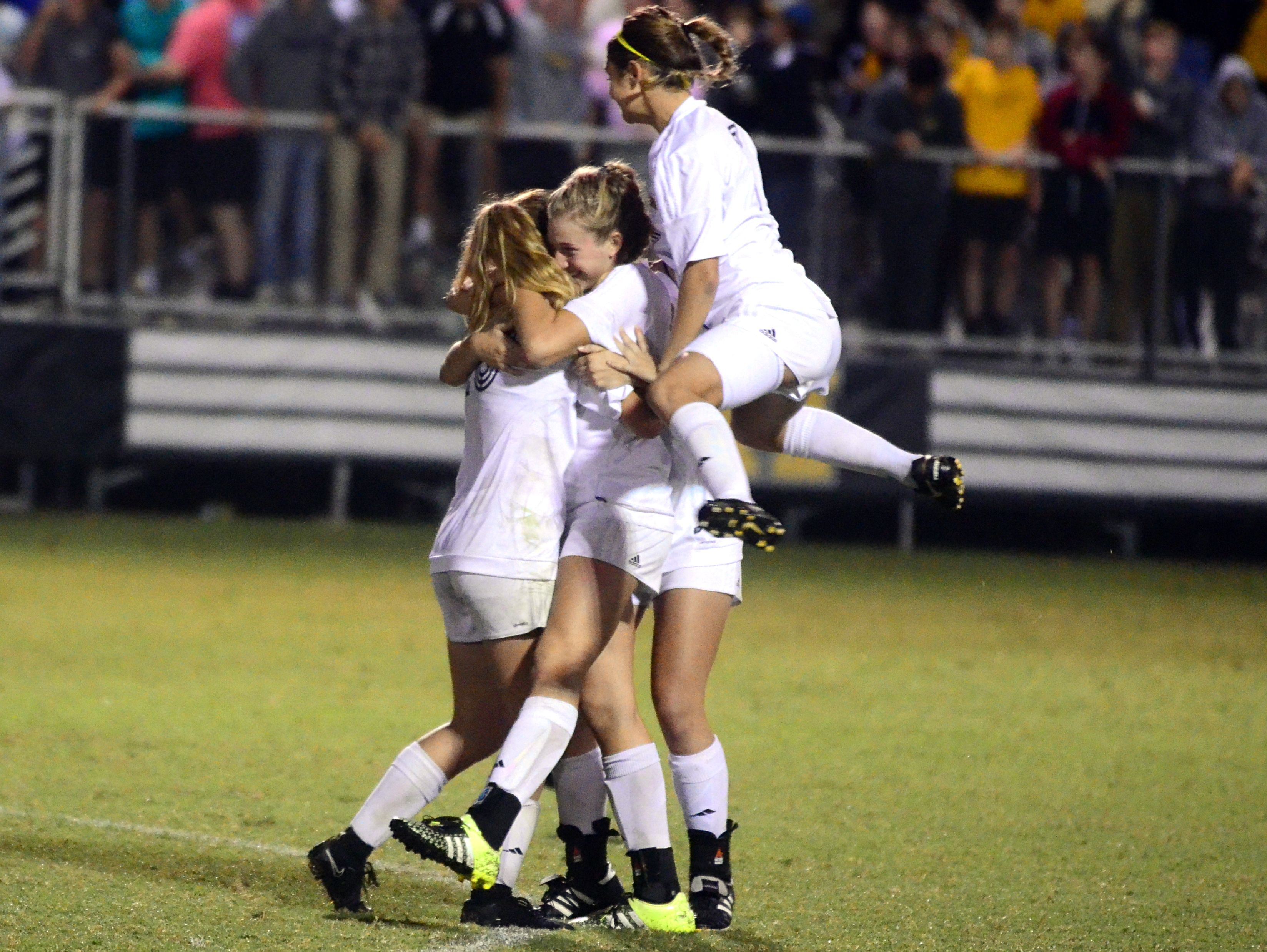 Hendersonville players celebrate after winning the District 9-AAA Tournament championship match on Wednesday evening.