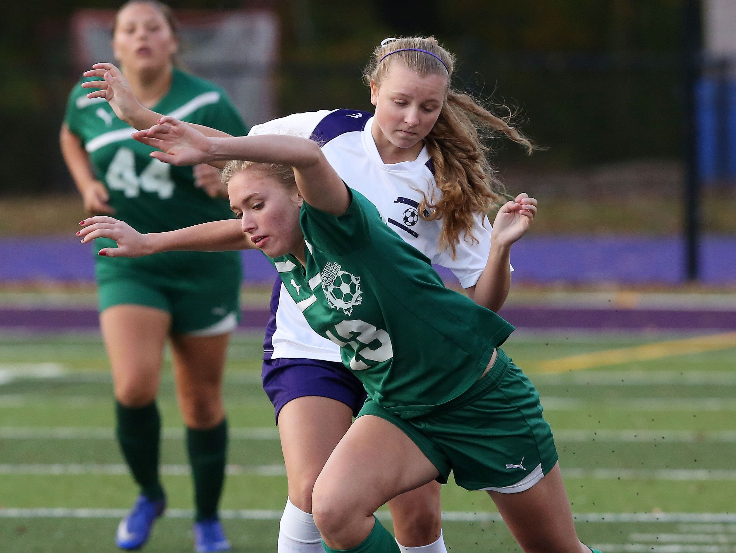 John Jay's Hannah Dieck (16) and Brewster's Tara Regan (13) battle for ball control during a soccer game at John Jay High School in Cross River Oct. 13, 2016. John Jay won the game 6-0.