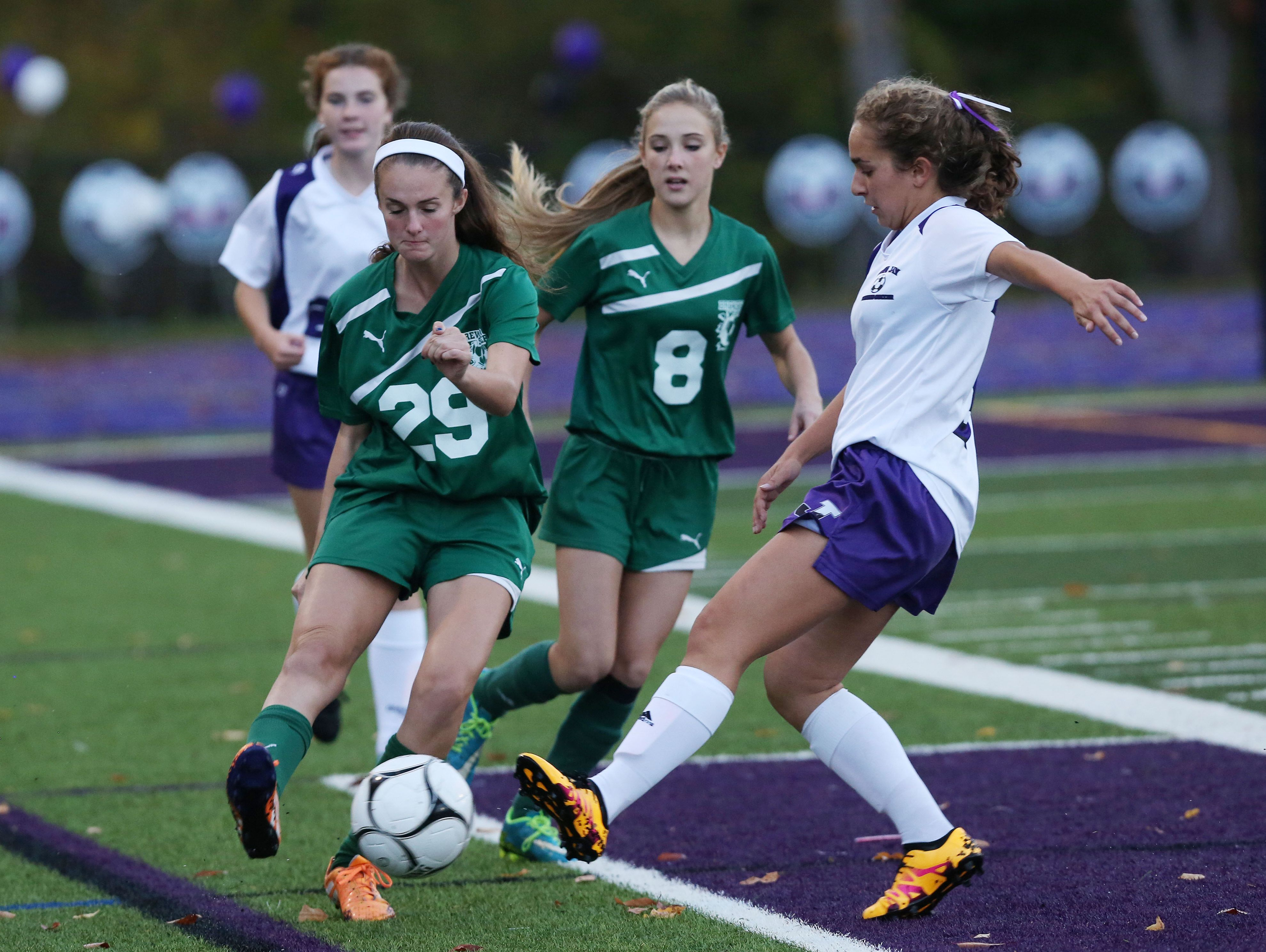 Brewster's Maggie Depaoli, left, and John Jay's Kayla Brandt battle for ball control during their game at John Jay High School in Cross River on Thursday. John Jay won the game 6-0.