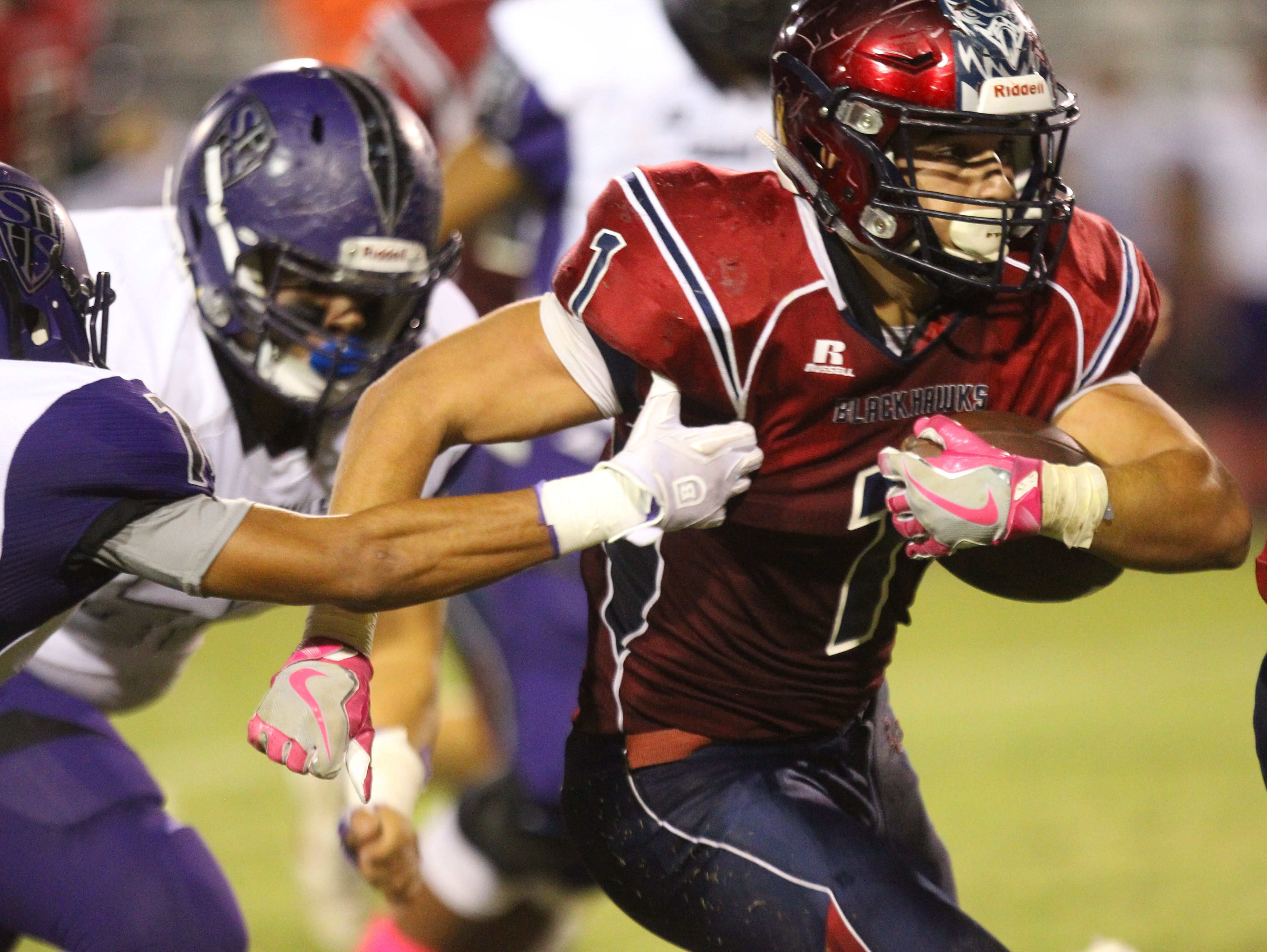 La Quinta High School's Benji Cordova runs for yardage against Shadow Hills High School at La Quinta.