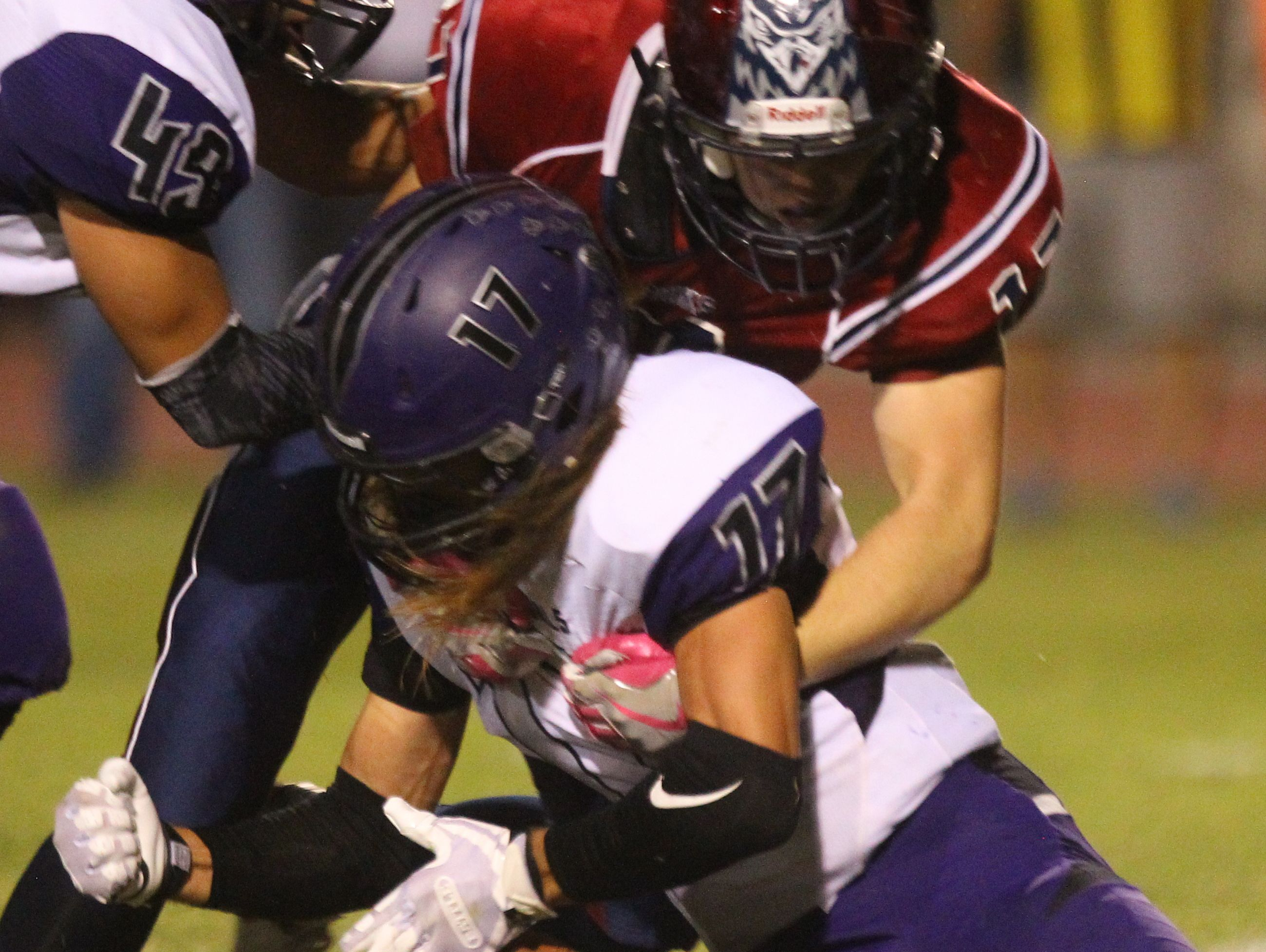 Shadow Hills High School's Jason JD Lang fumbles but is able to recover during a run against La Quinta High School.