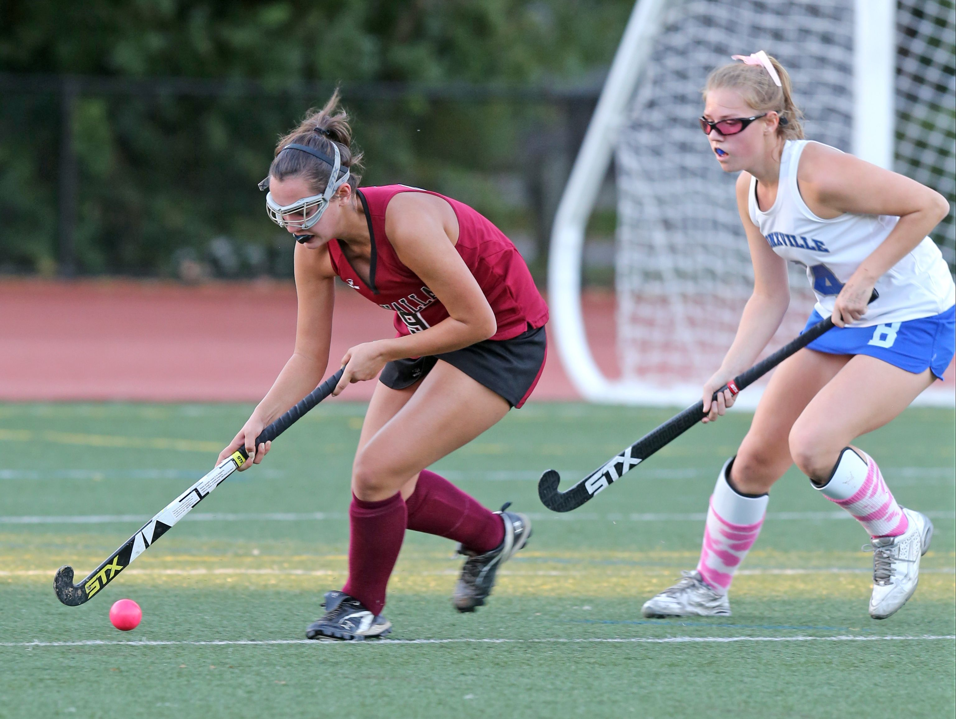 Valhalla's Lauren Kreder, left, tries to keep the ball from Bronxville's Hadley Barr during their game at Bronxville High School on Friday. The Broncos defeated the Vikings 3-1.