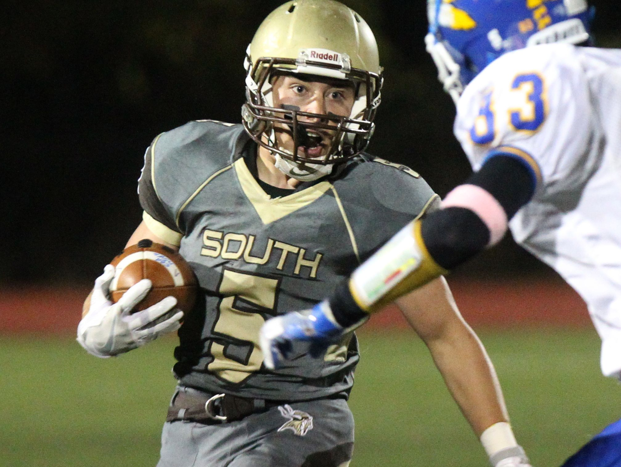 Clarkstown South's Ryan Thomas carries the ball during a Class AA playoff game at with Mahopac at Clarkstown South Oct. 14, 2016.