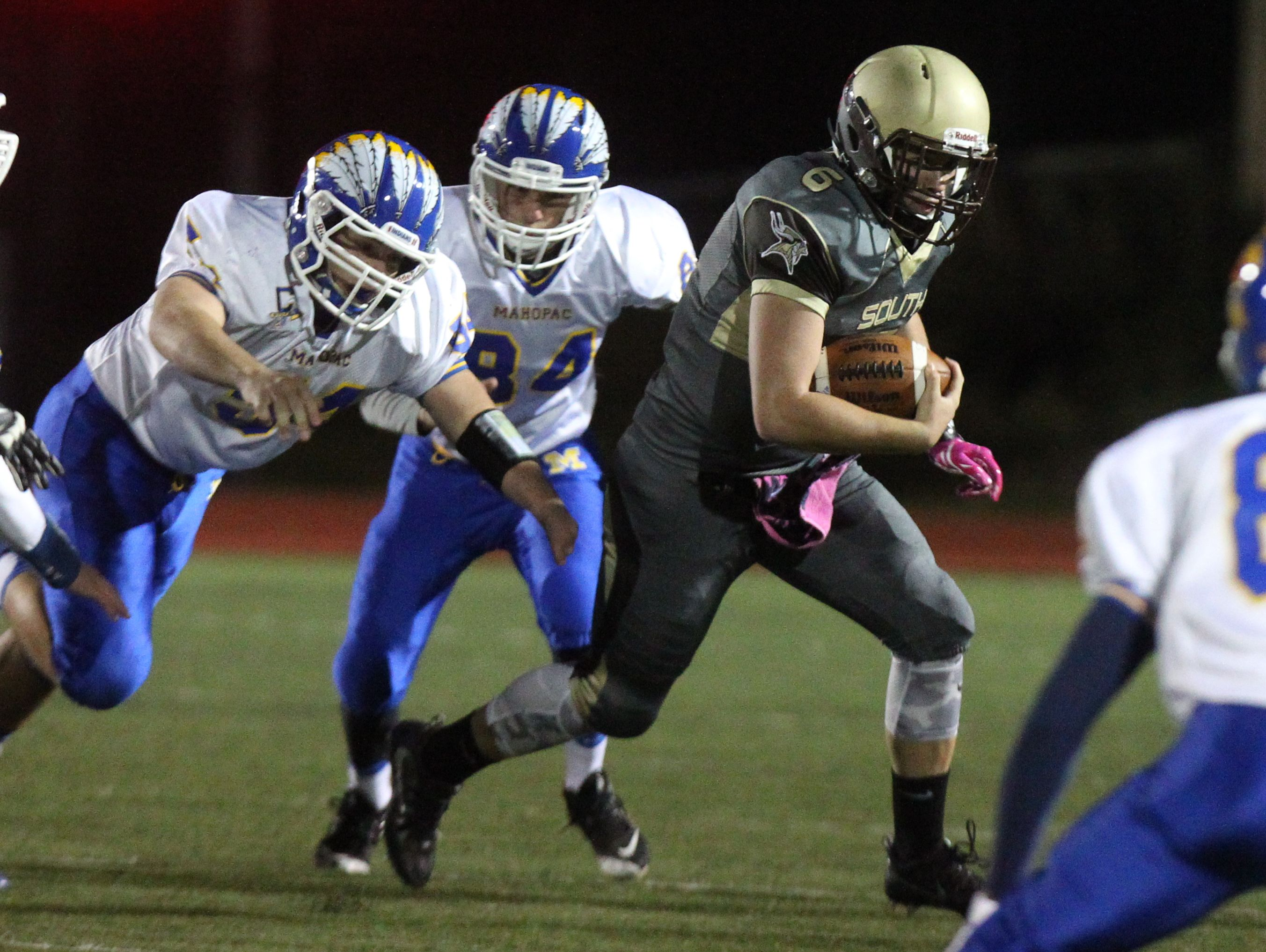 Clarkstown South quarterback Matt Jung carries the ball during a Class AA playoff game at with Mahopac at Clarkstown South Oct. 14, 2016.