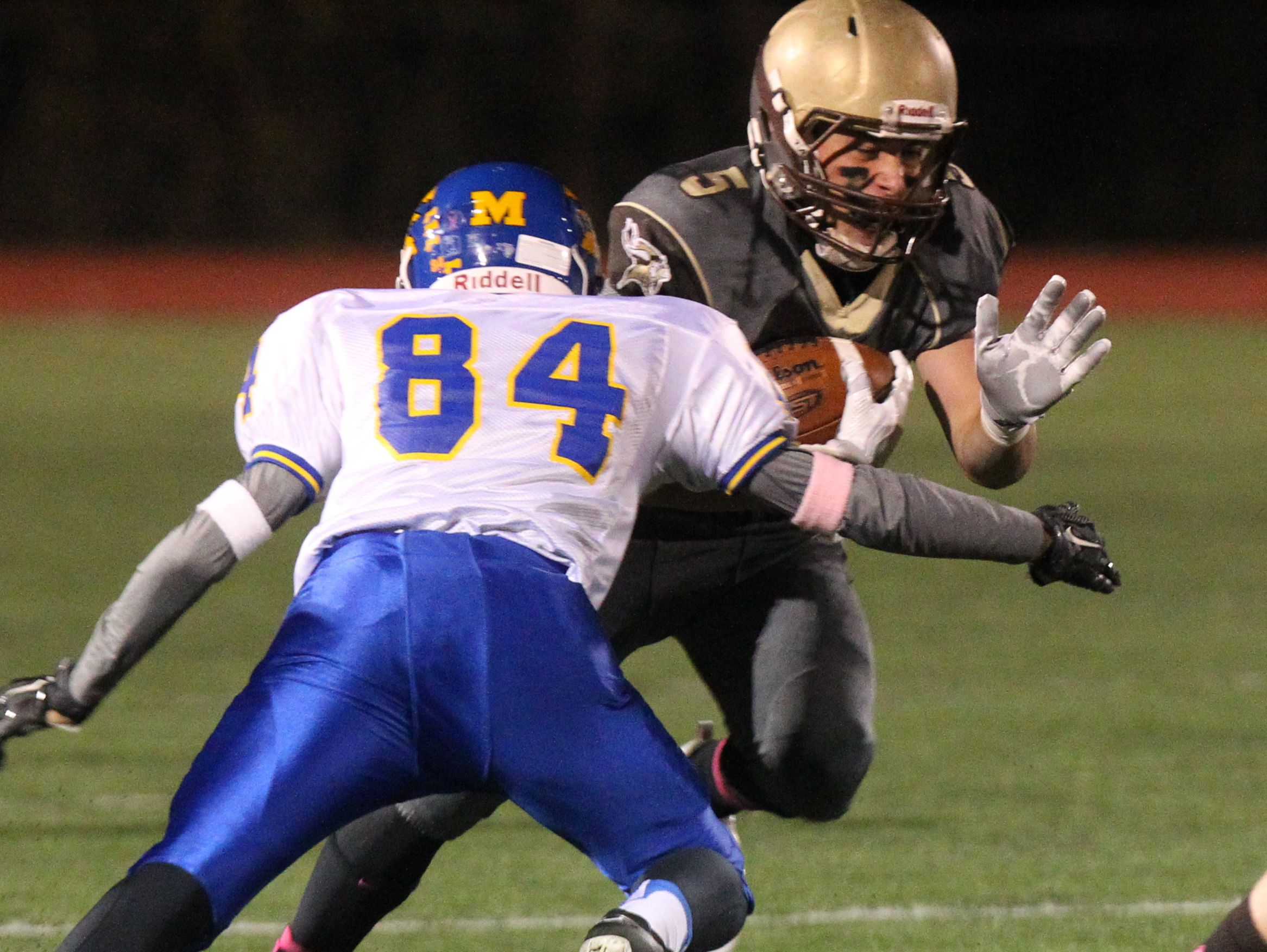 Clarkstown South's Ryan Thomas is tackled by Mahopac's Brendan Diorio during their Class AA playoff game at Clarkstown South Oct. 14, 2016.