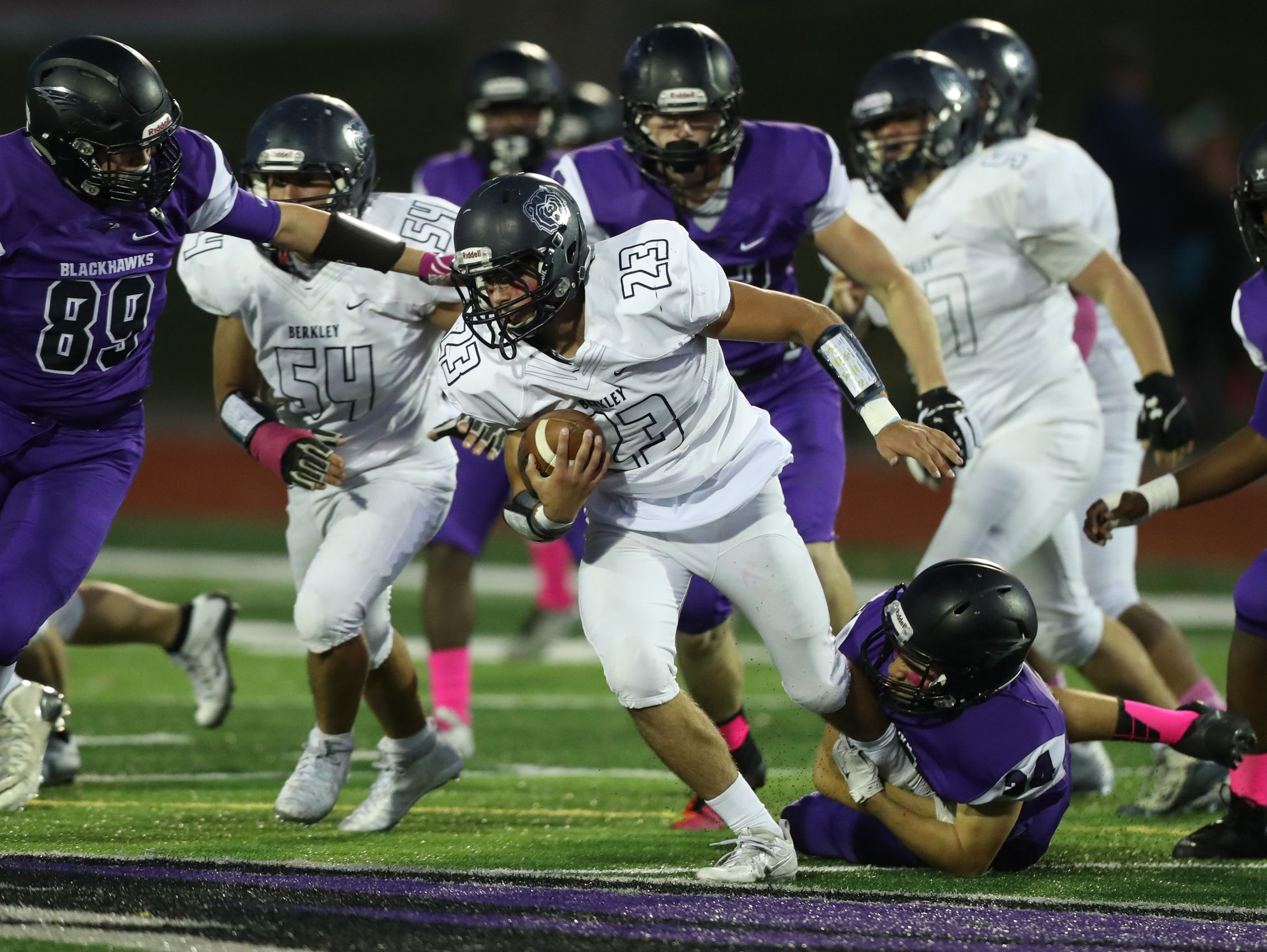 Bloomfield Hills' Patrick Najor tackles a Berkley ballcarrier during Bloomfield Hills' 42-16 win Friday at West Bloomfield.