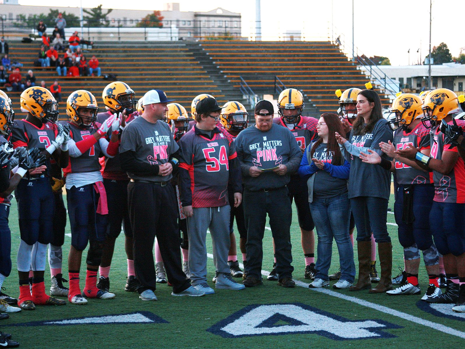 The Battle Creek Central High School football team presents a check to Michael Miller, a freshman at BCC has brain cancer