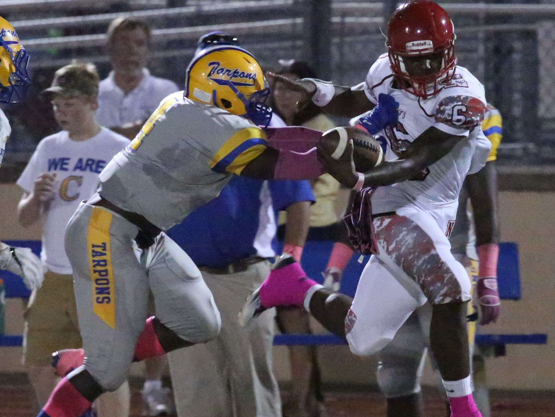 North Fort Myers Zaquandre White is pushed out of bounds by a Charlotte player as he gained yards. North Fort Myers played at Charlotte Friday night.