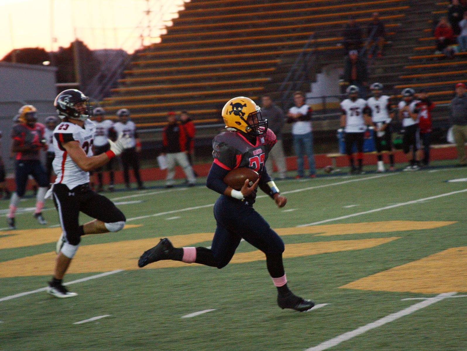 Battle Creek Central's Kevin Adams breaks loose for a 63-yard touchdown reception against St. Johns on Friday.