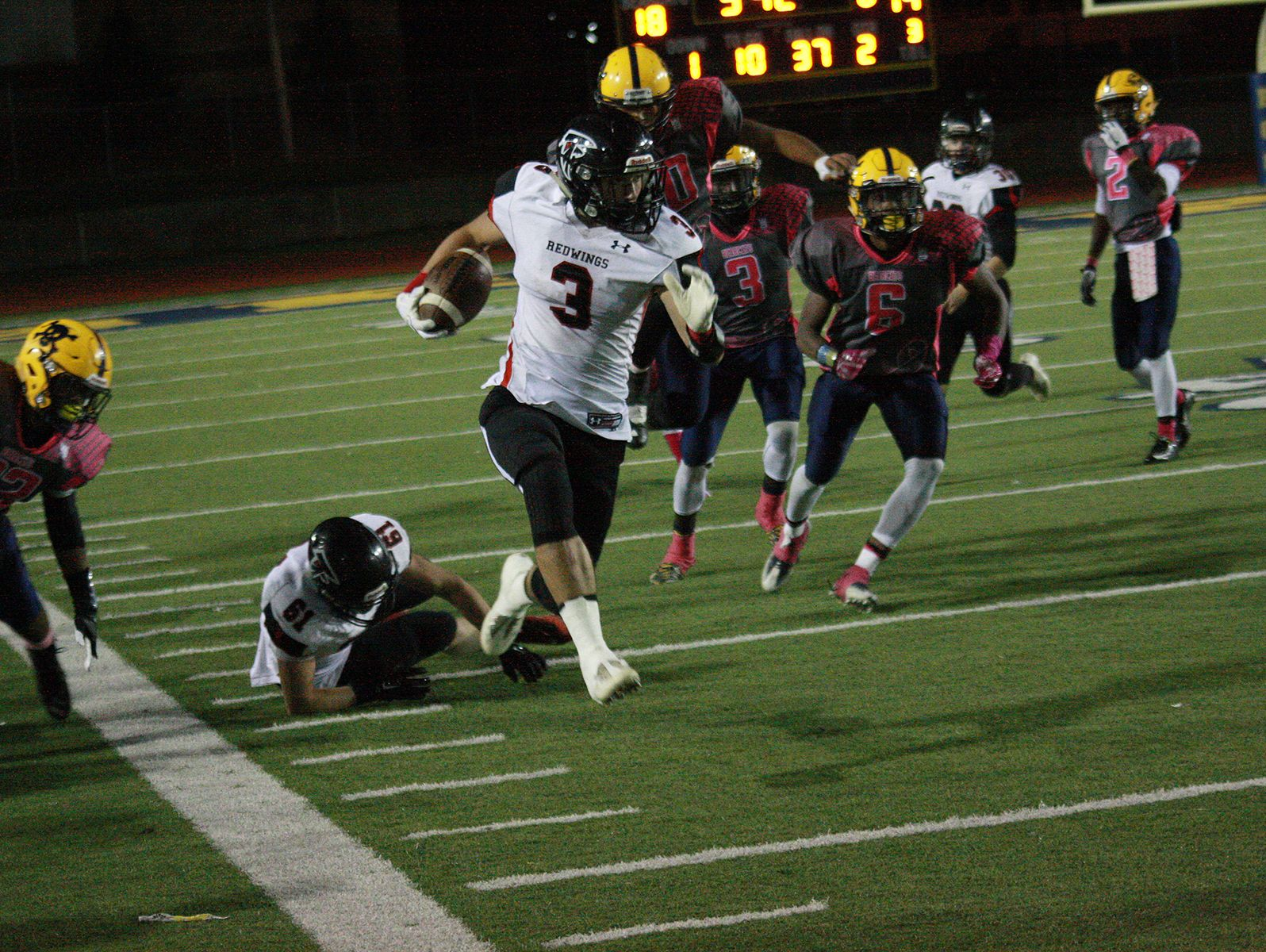 St. John's Jack Bouck scores a 63-yard touchdown reception against Battle Creek Central on Friday.