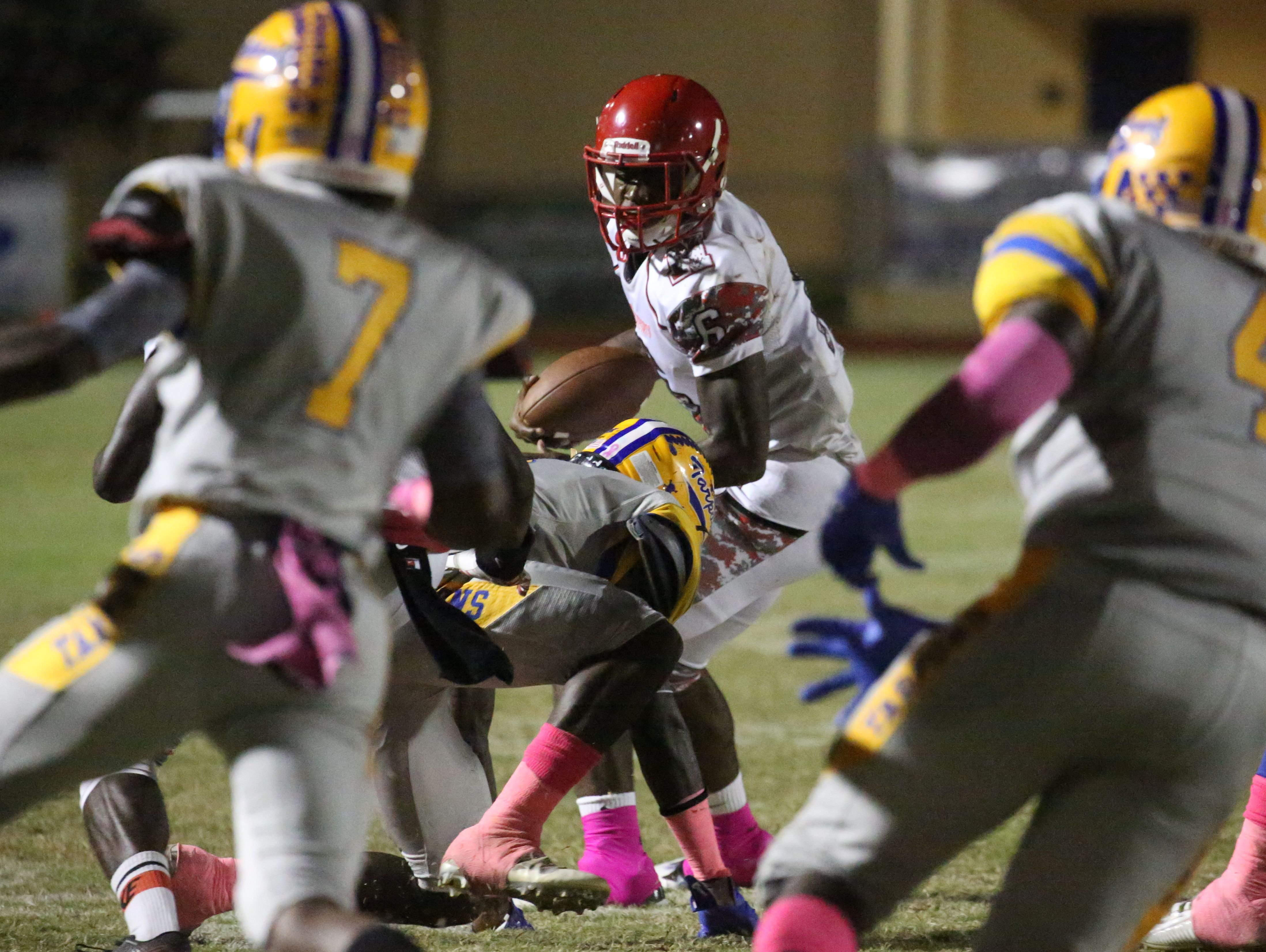 North Fort Myers' Zaquandre White looks for an opening as he gains yards as North Fort Myers played at Charlotte Friday night.