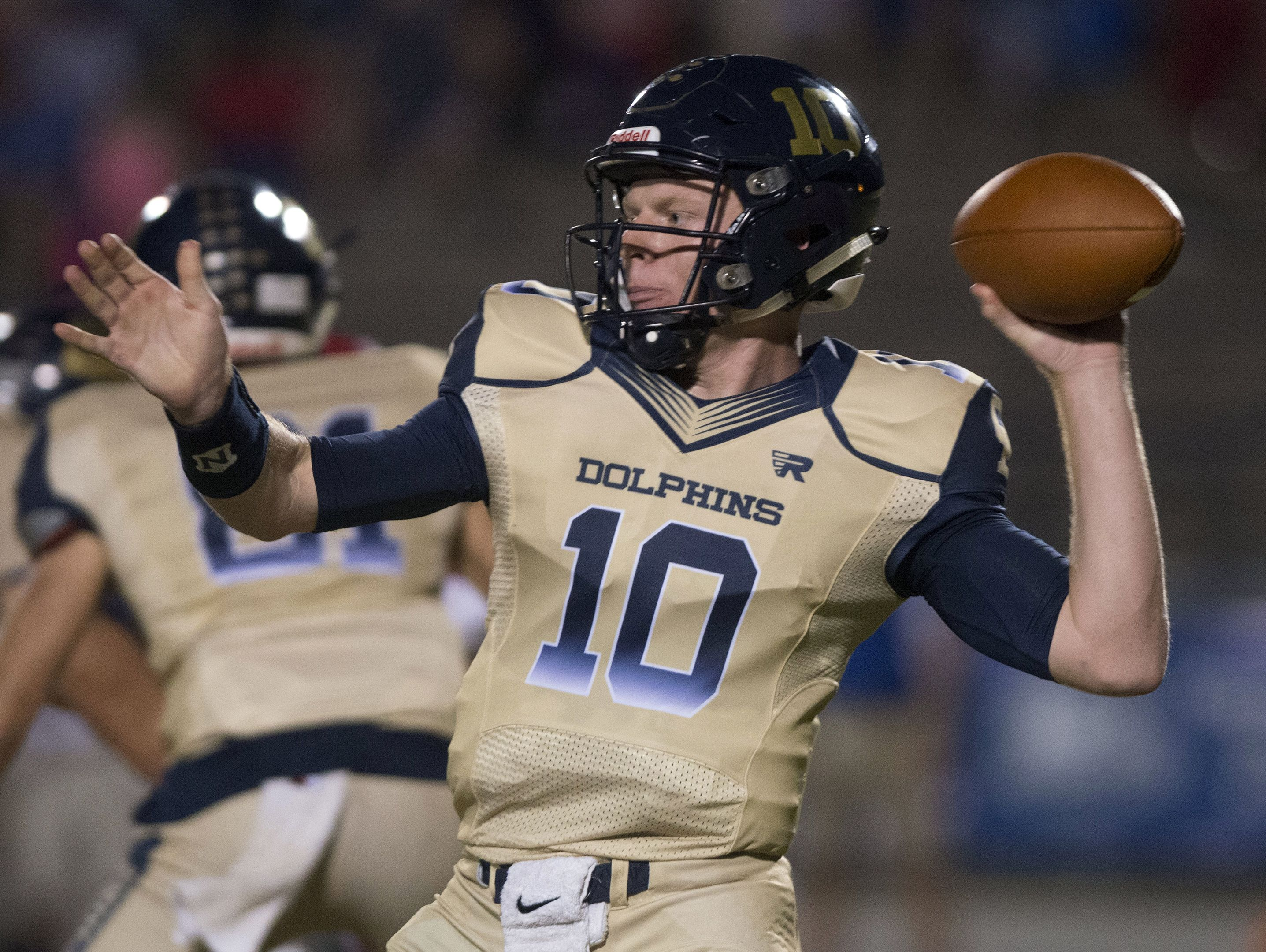 Gulf Breeze quarterback, Tyler Phelps, (No. 10) sends the football down field to an open to a receiver during Friday night's District-2 6A game.