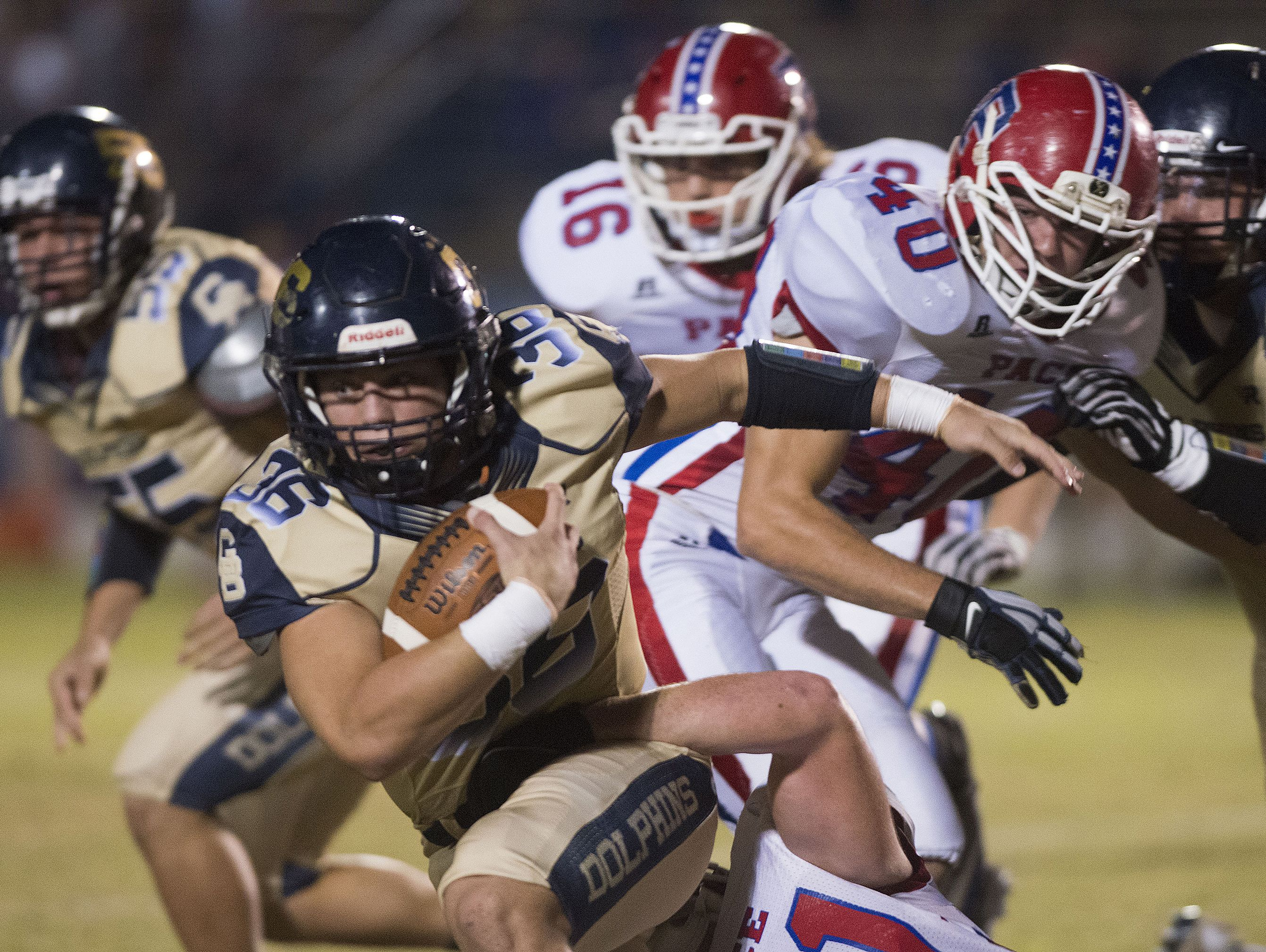 Gulf Breeze running back, Tyler Dittmer, (No. 36) gets wrapped by the Pace defense during Friday night's District-2 6A game.