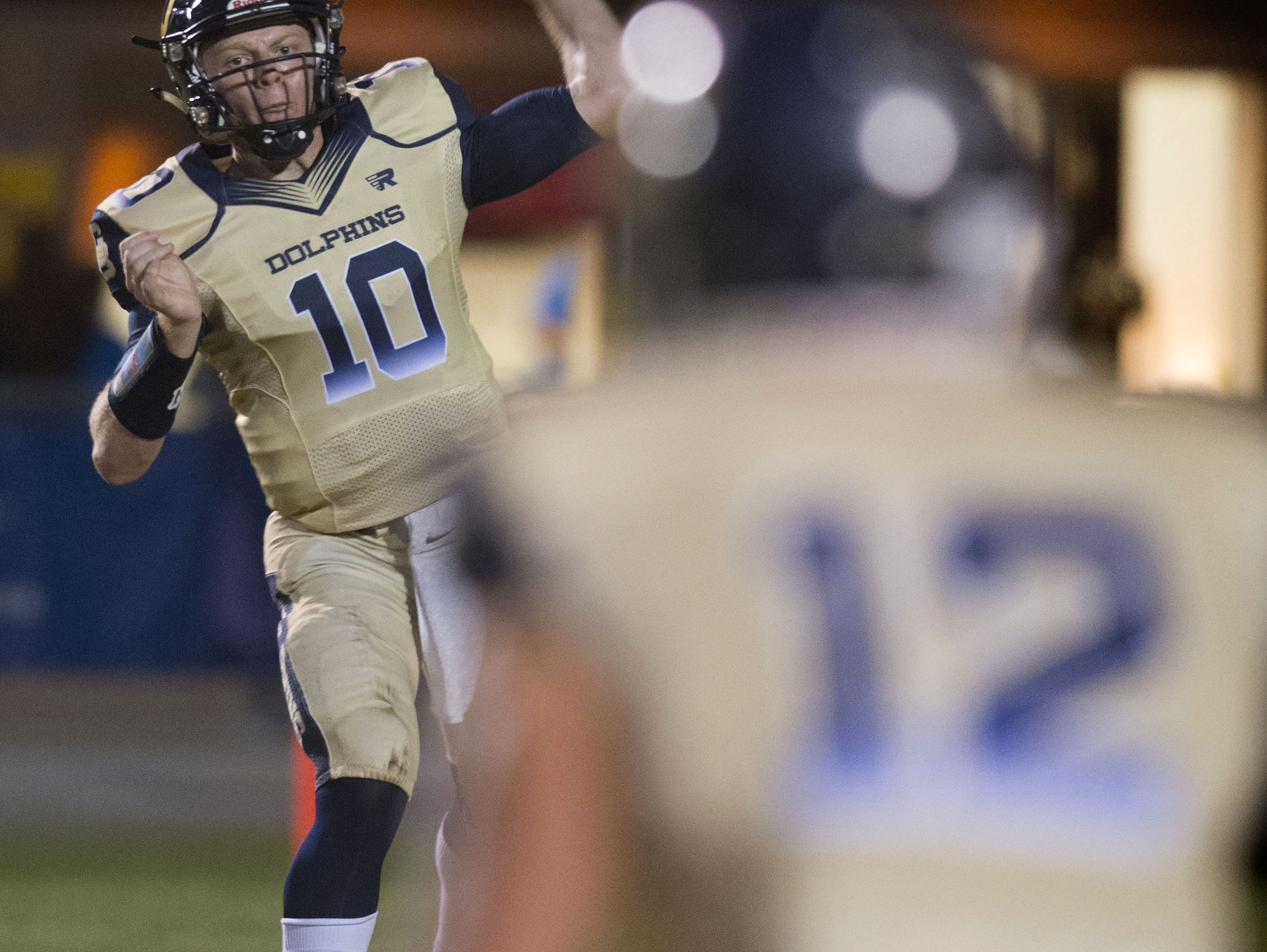 Gulf Breeze quarterback, Tyler Phelps, (No. 10) gives a quick pass to receiver, Cole Sheppard, (No.12) during Friday night's District-2 6A game.