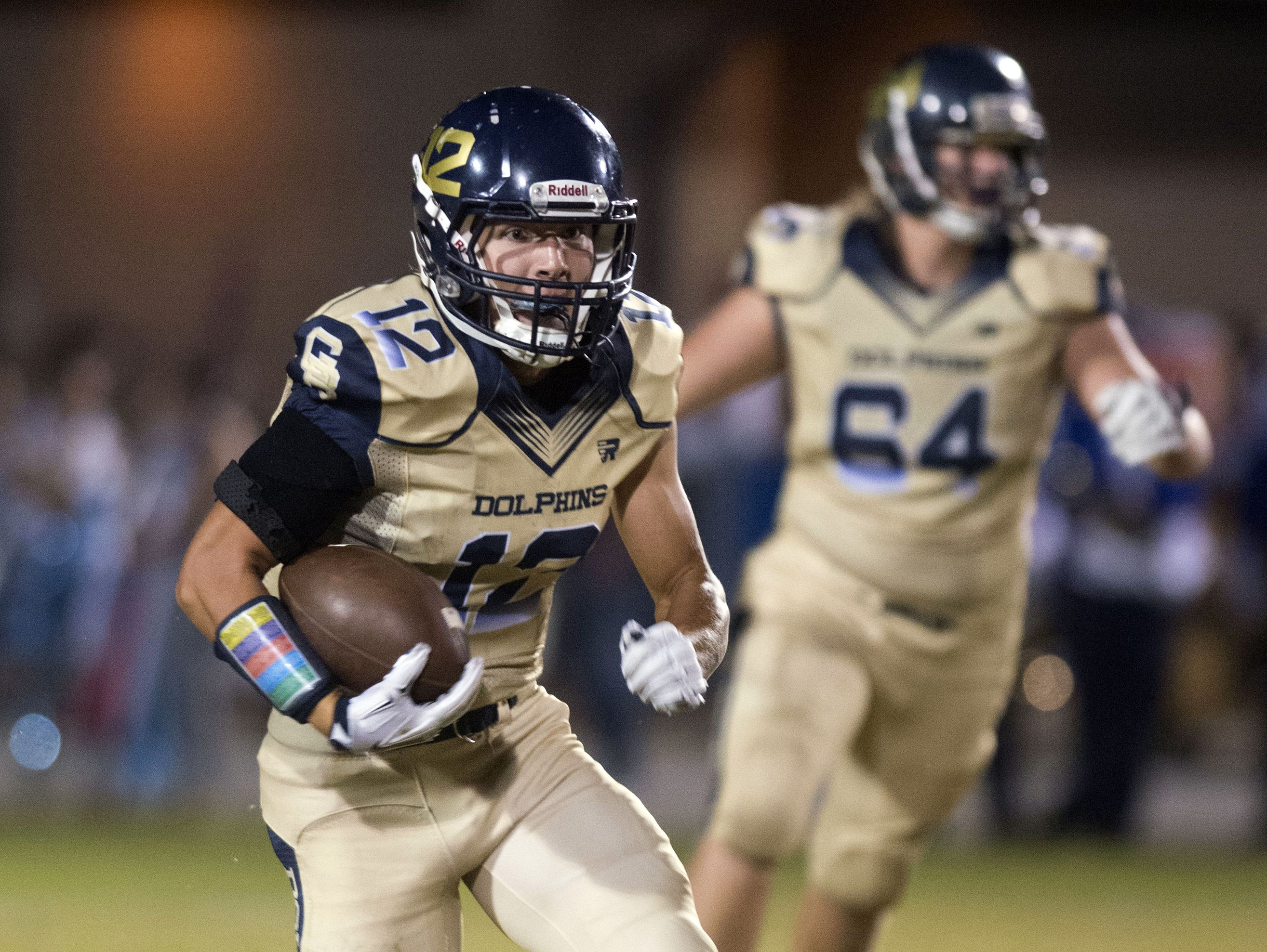 Gulf Breeze High School wide receiver, Cole Sheppard, (No. 12) runs up field for a big gain against the Pace High School defense Friday night's District 2-6A game.