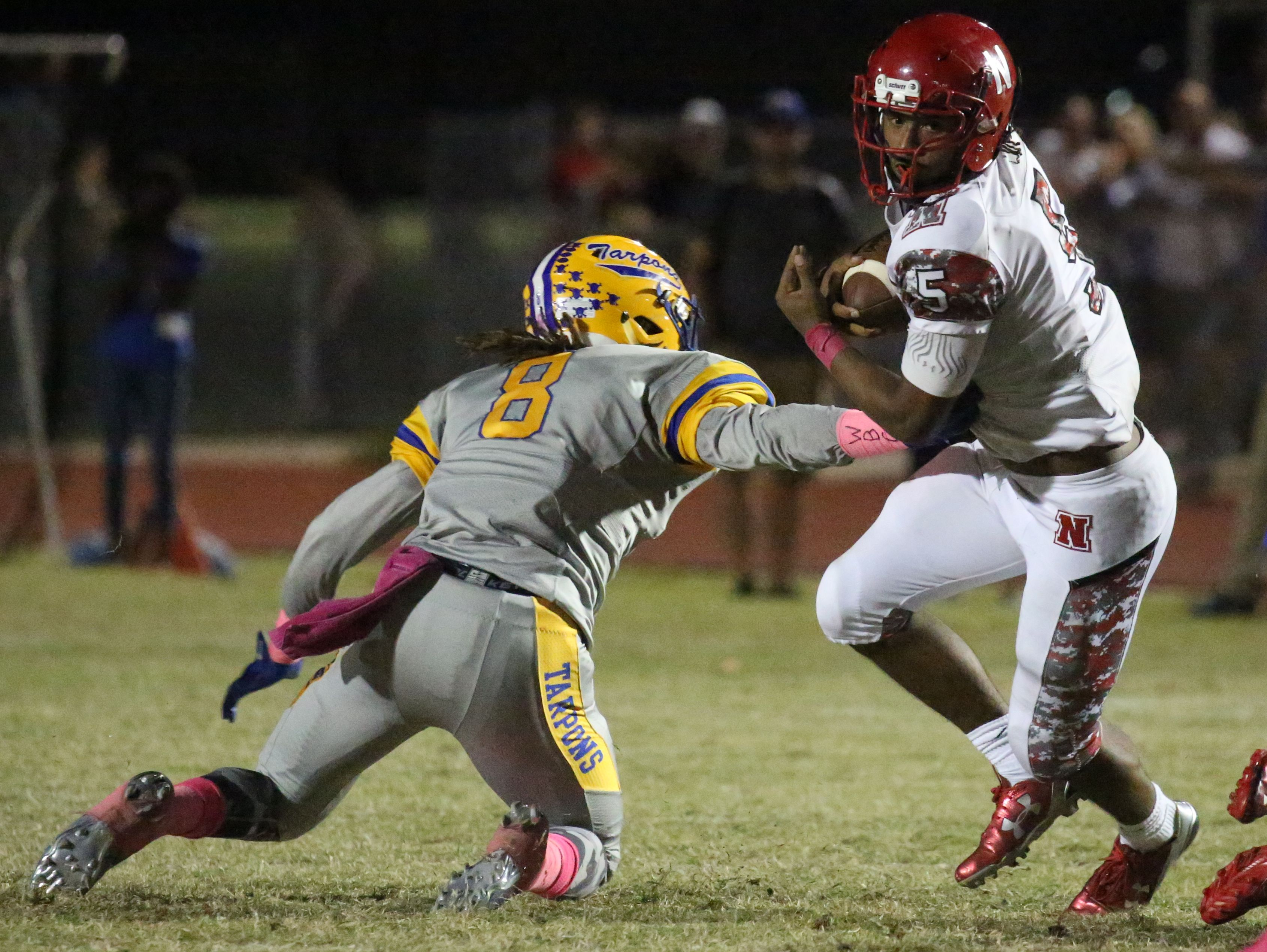 North Fort Myers' Fanajae Gotay tries to break from Charlotte's G'Vonte Price as North Fort Myers played at Charlotte Friday night.
