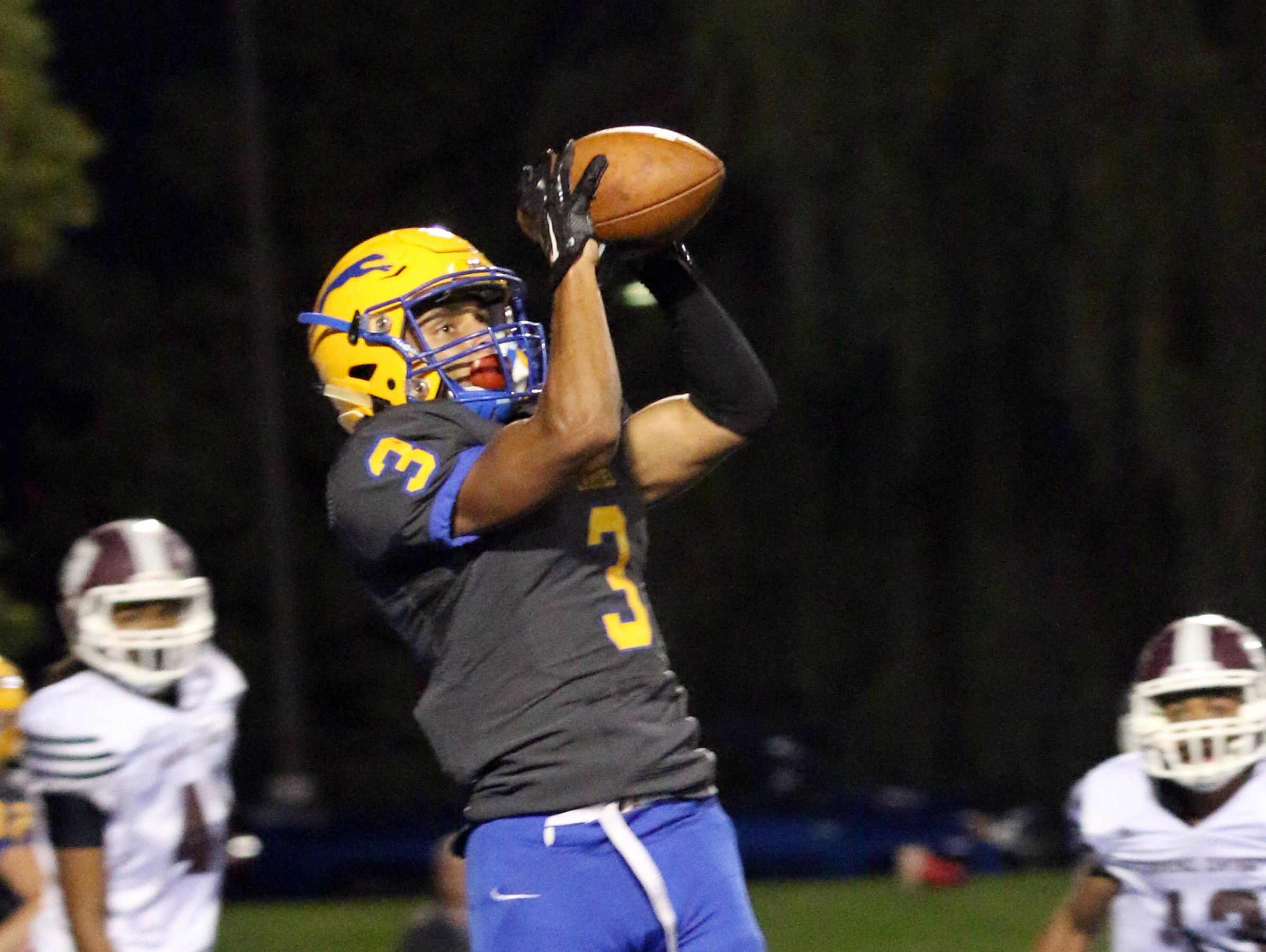 Carmel's Jalen Walker caught a school-record four touchdown passes in the Greyhounds 35-20 win on Friday night.