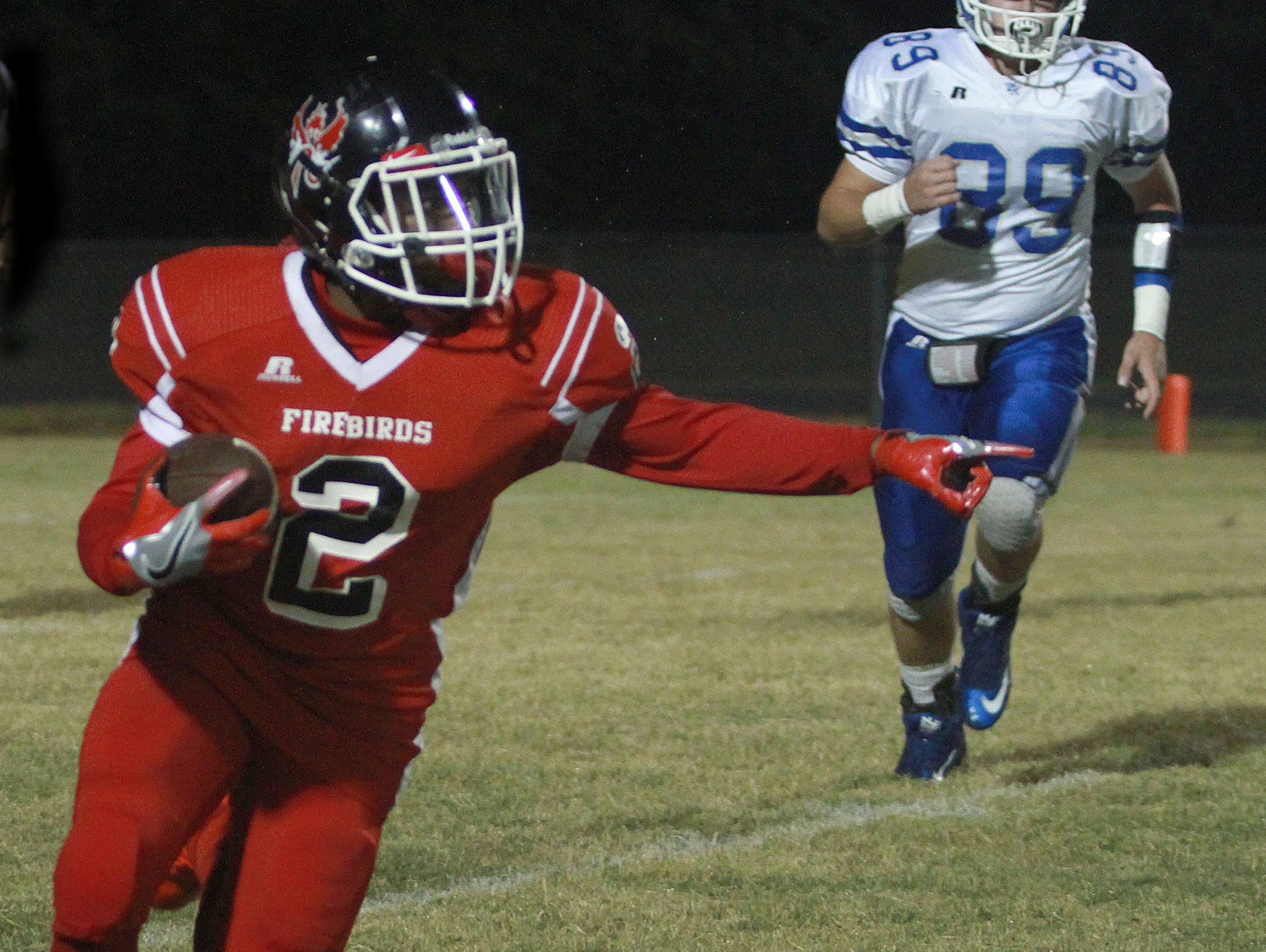 Pearl-Cohn's Jimmyrious Parker fields a punt and points for blockers in Nashville, TN on Fri. Oct. 14, 2016.