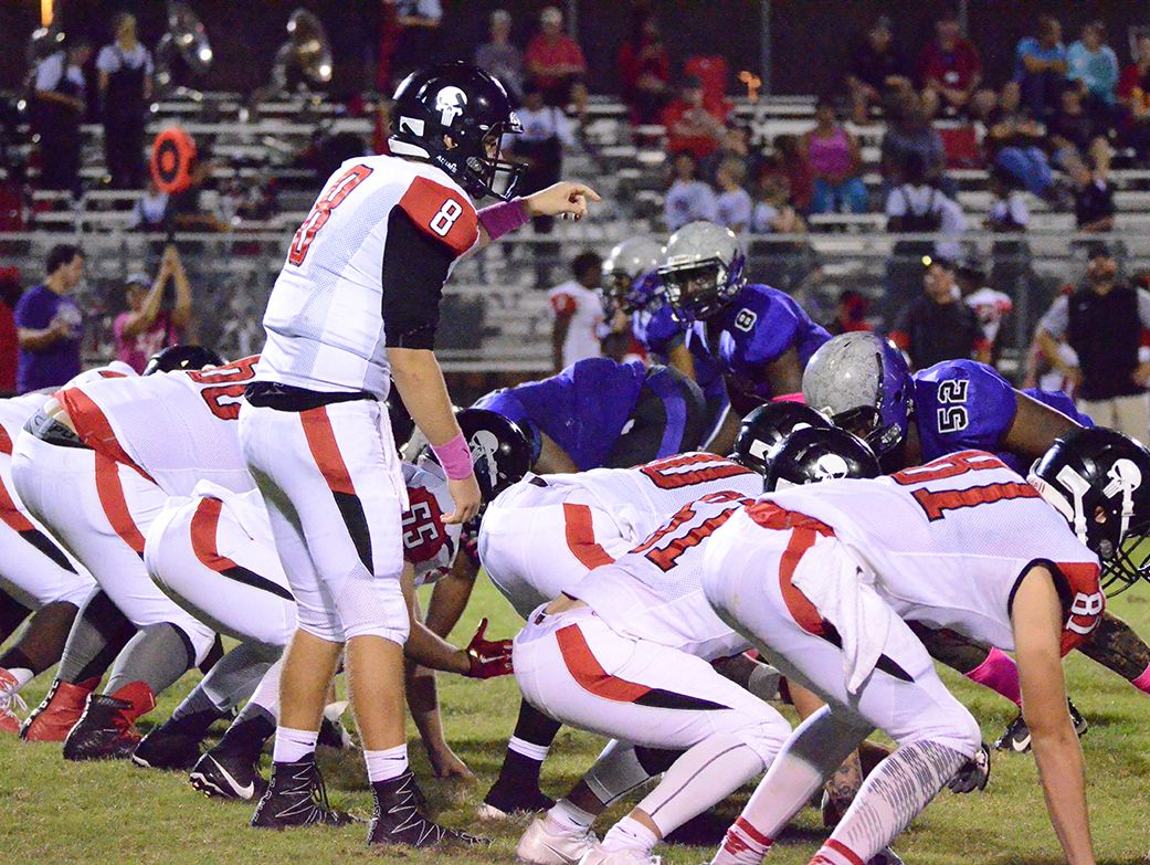 Palm Bay quarterback Stuart Brown points out offensive commands Friday night as Palm Bay visited Space Coast.