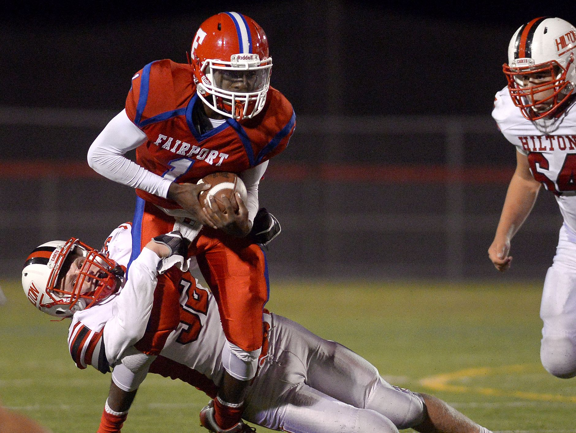 Fairport's Keshawn Howard tries to break the grasp of Hilton's Maxwell Chamberlain last week. Howard and his teammates improved Fairport's record to 6-1.