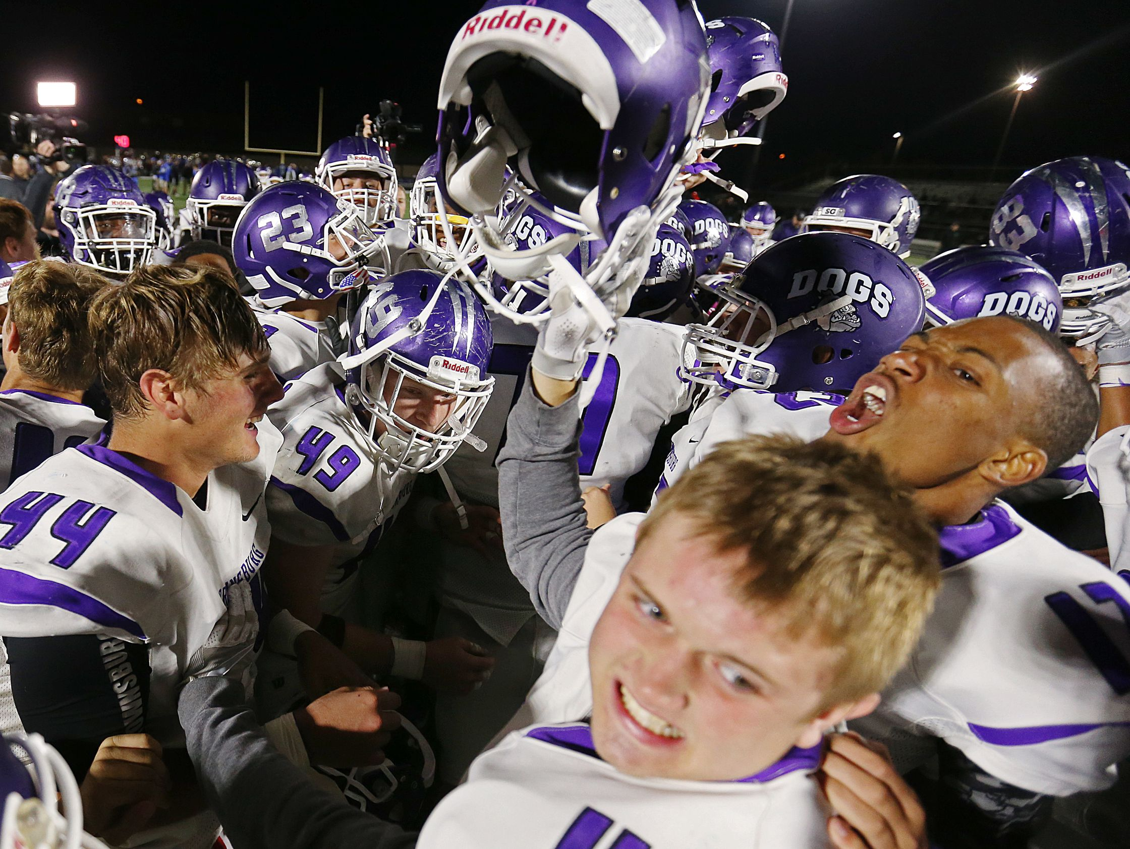 The Brownsburg Bulldogs celebrate their win against Hamilton Southeastern after the game, Fishers, Ind., Friday, October 14, 2016. Brownsburg won the Hoosier Crossroads Conference title, 35-24.