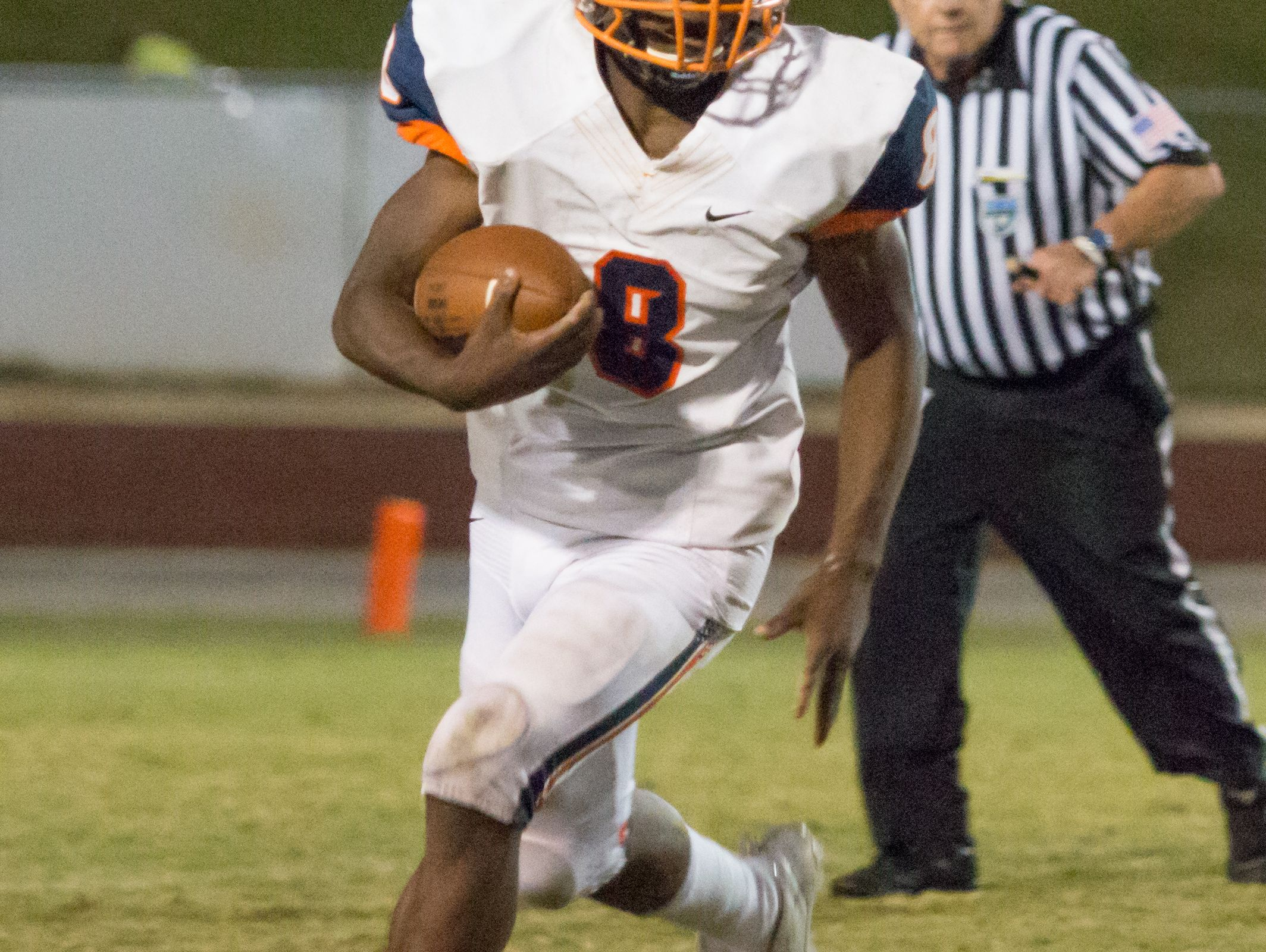 Escambia running back Queven Dosunma (8) looks up field after taking a handoff Friday night at Tate High School.