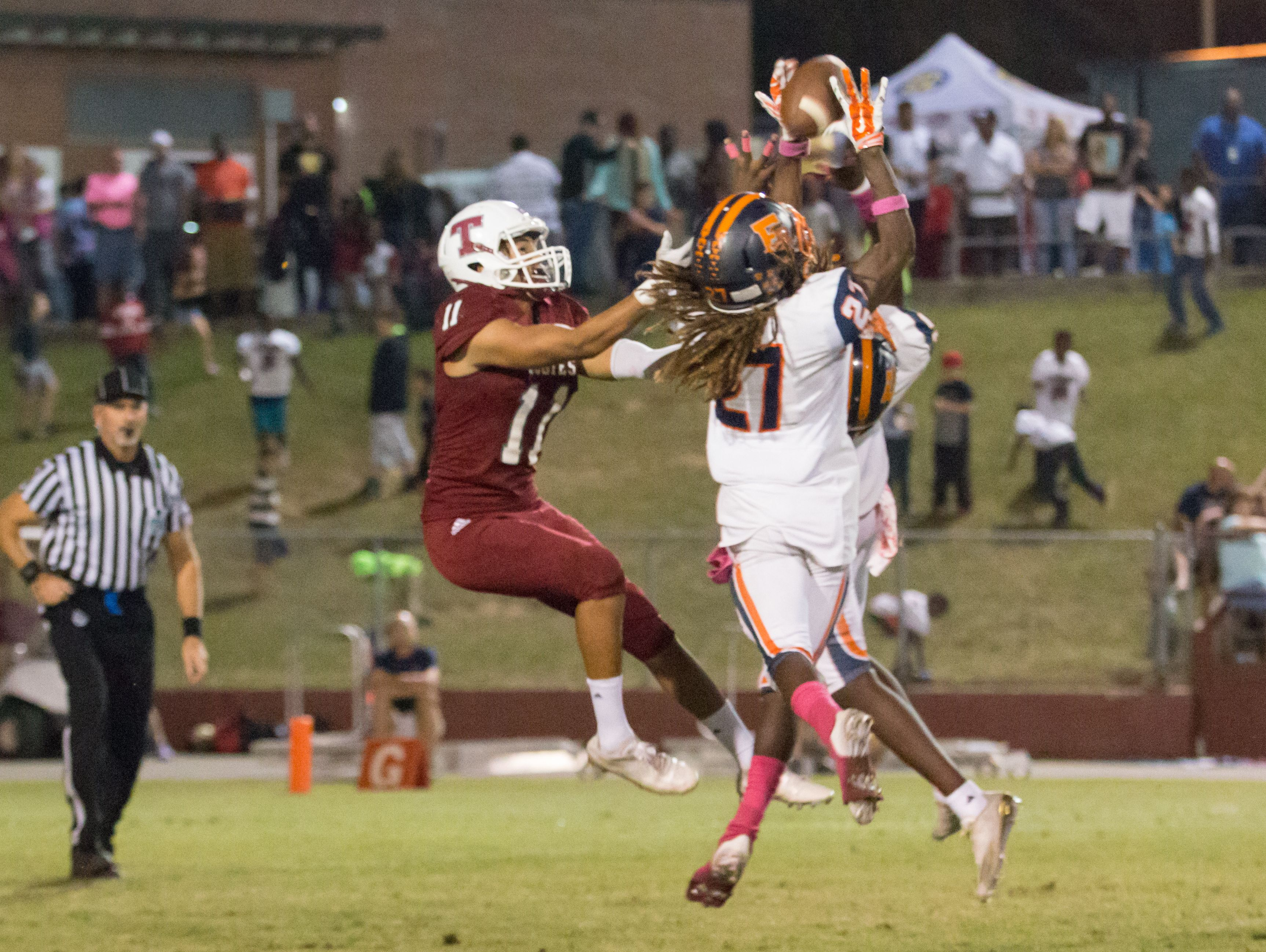 Escambia's Gerrold Nobles (27) breaks up a pass intended for Tate's Rodriguez Smith (11) Friday night at Tate High School.