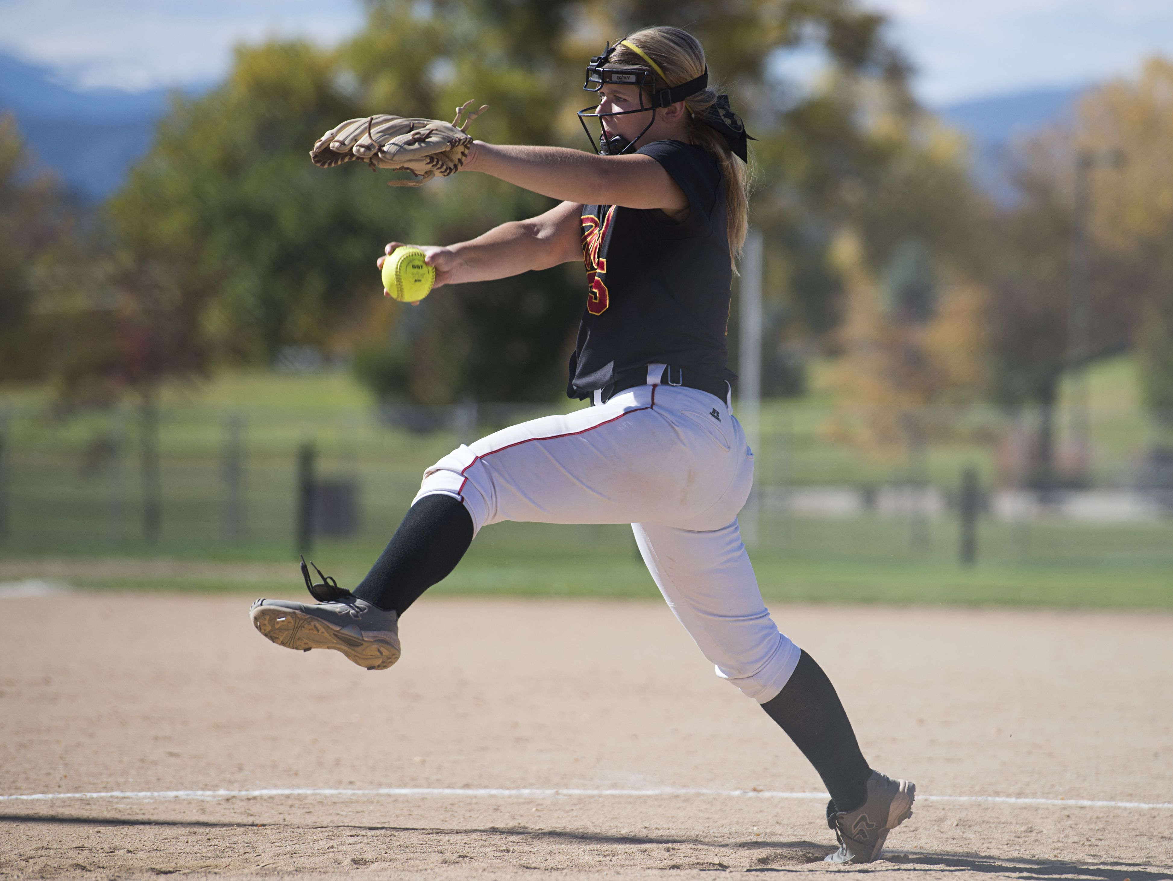 Rocky Mountain pitcher Kelli Schueller delivers the ball to a Loveland batter during a regional championship game at Barnes Sports Complex in Loveland Saturday, October 15, 2016.