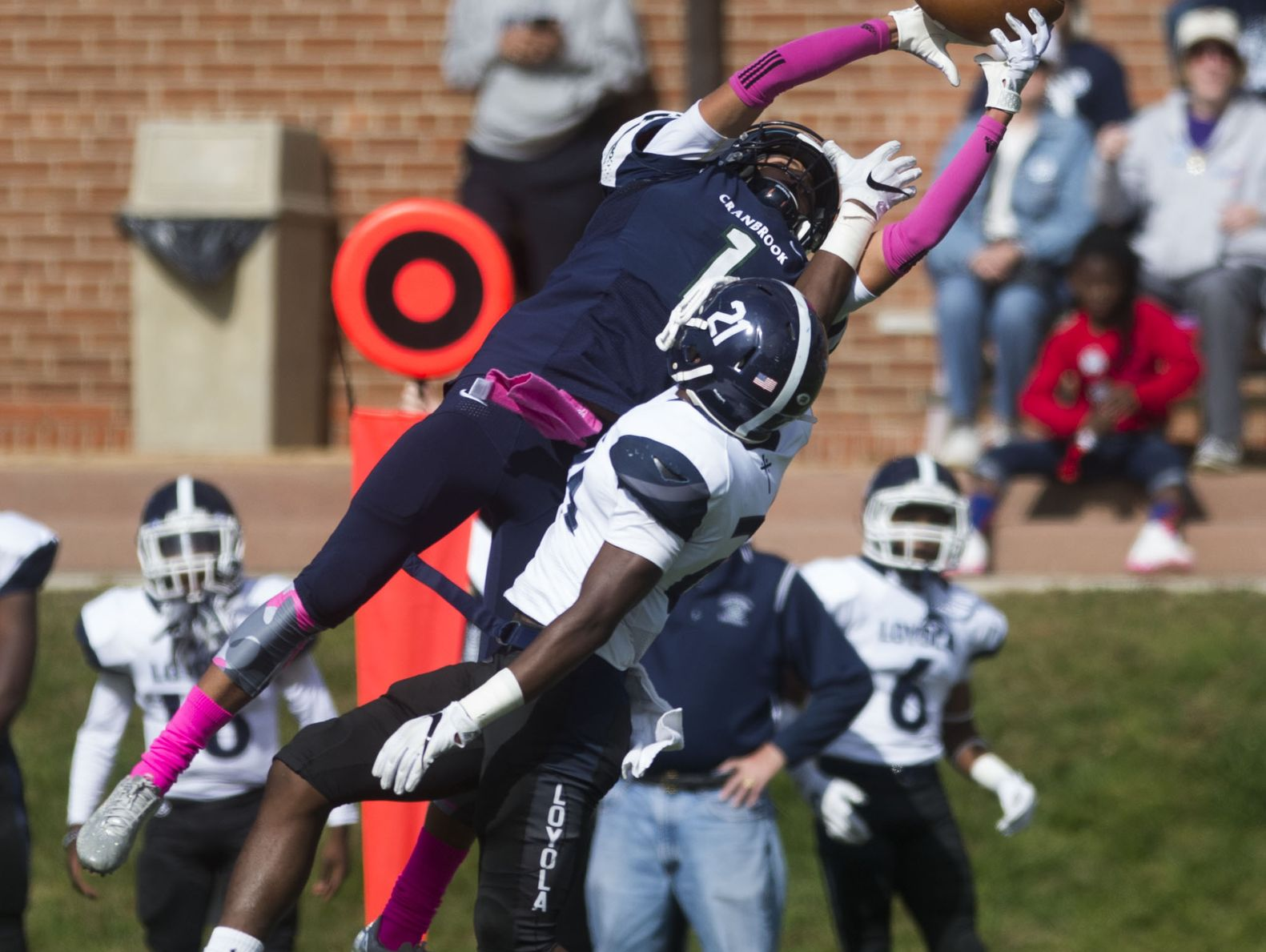 Bloomfield Hills Cranbrook player Kobi Russell (1) goes up for a catch against Detroit Loyola's Curtis Martin (21) during Loyola's 30-3 win over Cranbrook on Saturday in Bloomfield Hills.