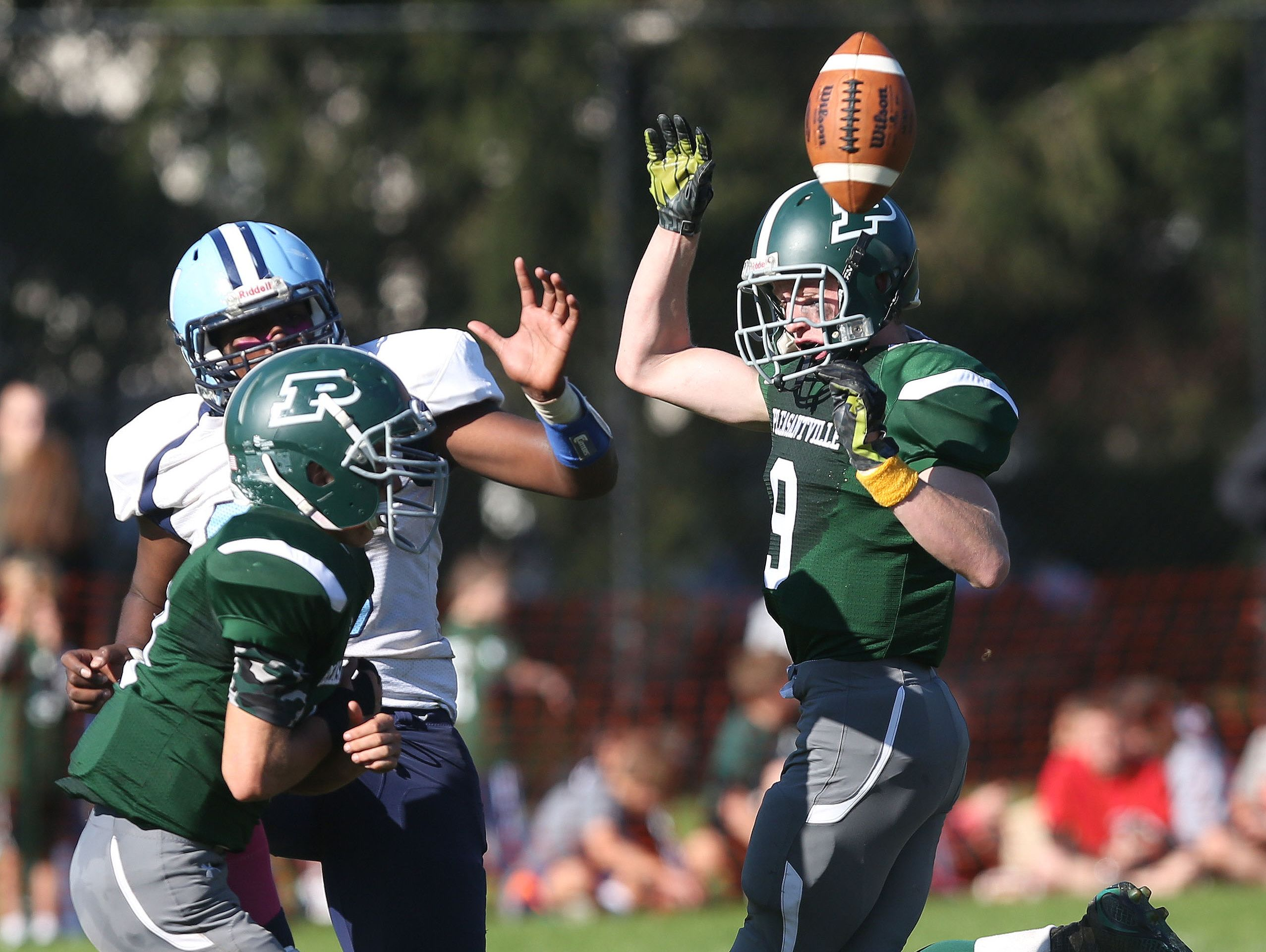 Pleasantville's Jake Farrelly (9) and Tim Stelzl (10) block a punt by Westlake's Camron Amerson (6) during football action at Parkway Field in Pleasantville Oct. 15, 2016. Pleasantville won the game 38-35.