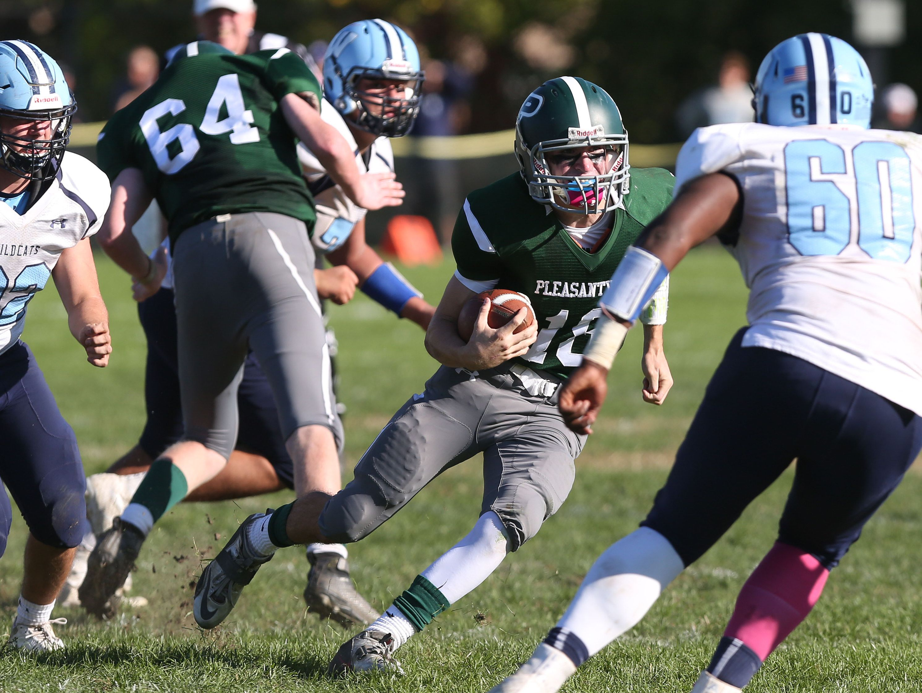 Pleasantville's Jack Howe (18) looks for some running room in the Westlake defense on a first half run during football action at Parkway Field in Pleasantville Oct. 15, 2016. Pleasantville won the game 38-35 on a last second field goal by Howe.
